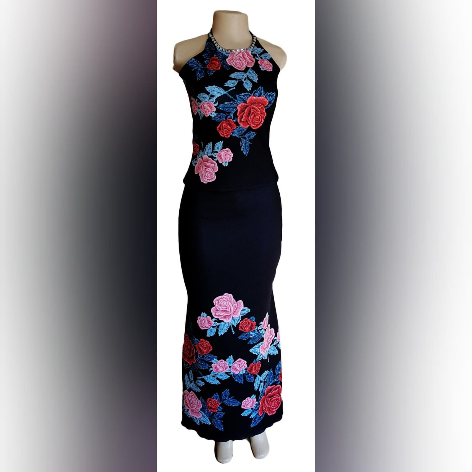 2 piece black floral evening wear 1 2 piece black floral evening wear with a fitted long skirt and halter neck top.