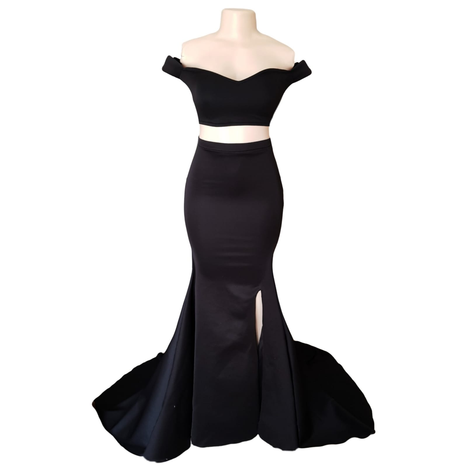 2 piece black off shoulder matric dance dress with a crop top 6 2 piece black off shoulder matric dance dress with a crop top. Lace-up back. Long skirt with knee length slit and a train.