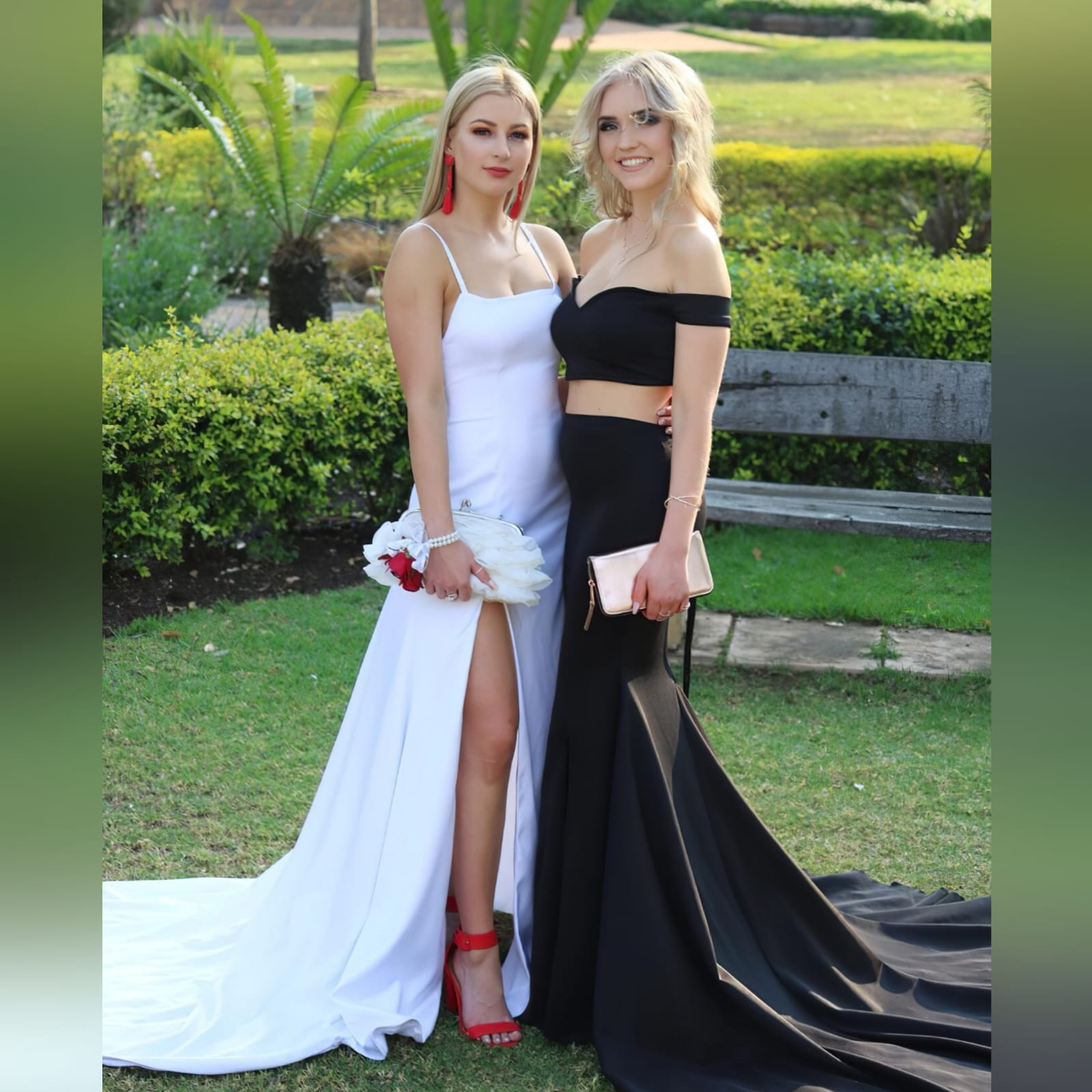 2 piece black off shoulder matric dance dress with a crop top 4 2 piece black off shoulder matric dance dress with a crop top. Lace-up back. Long skirt with knee length slit and a train.