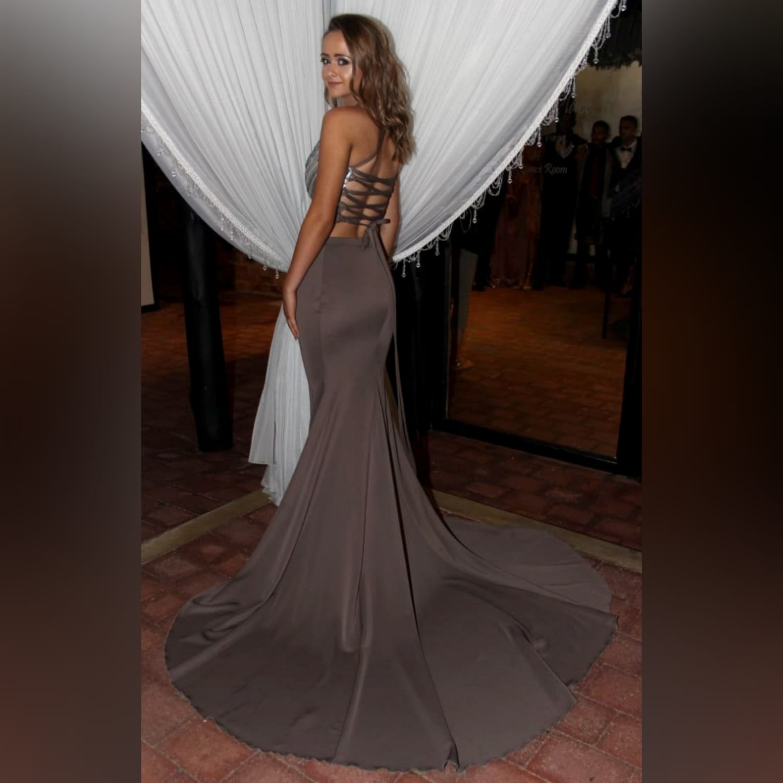 2 piece brown gray prom dress 1 2 piece brown gray prom dress. Skirt as a soft mermaid. Top with an open lace up back. Bust detailed with sequins. With a long train.