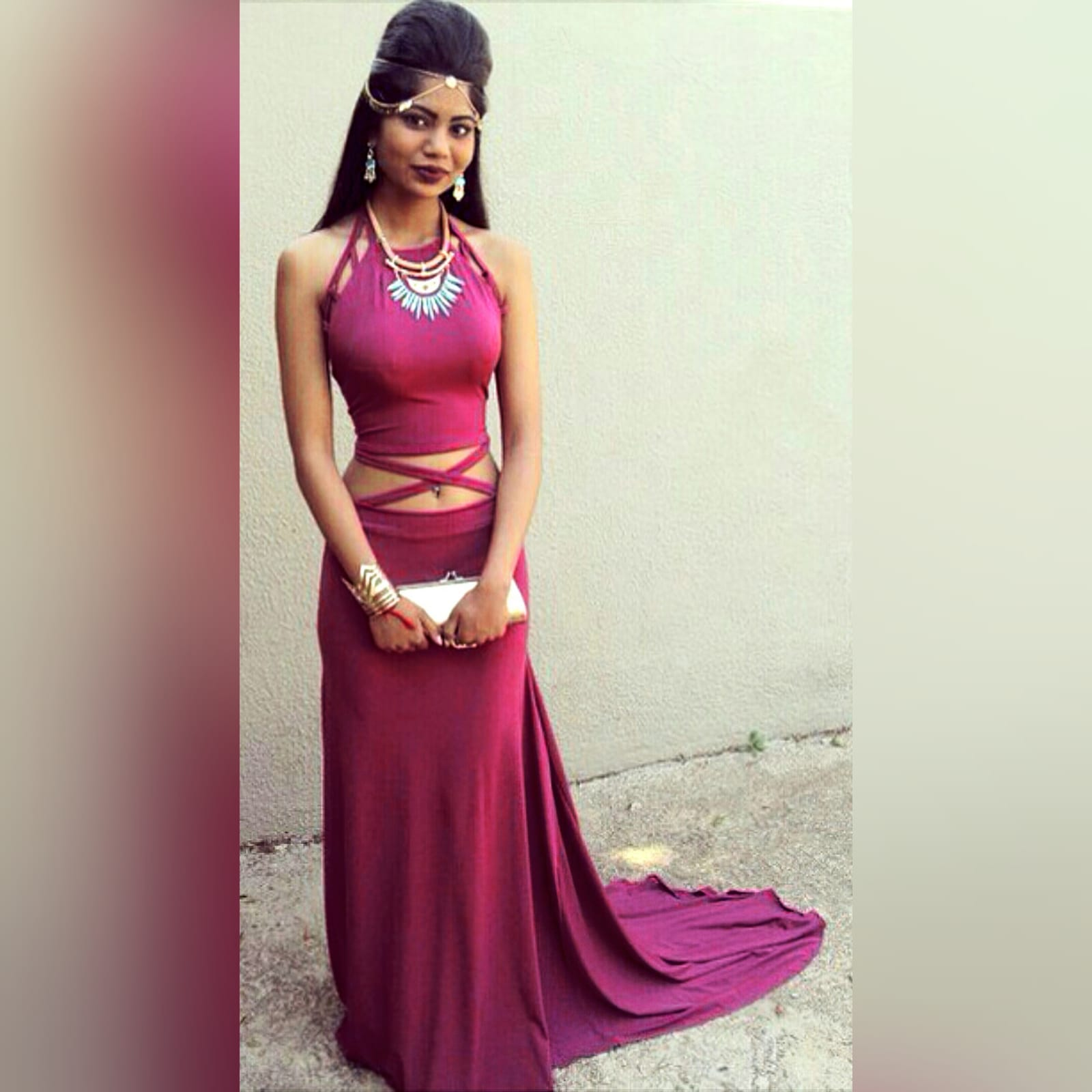 2 piece plum prom dance dress 1 2 piece plum prom dance dress. Halter neck crop top. Straps from the crop top create a cross that joins to the skirt. Skirt fitted till the hip and then very flowy with a long, wide train.