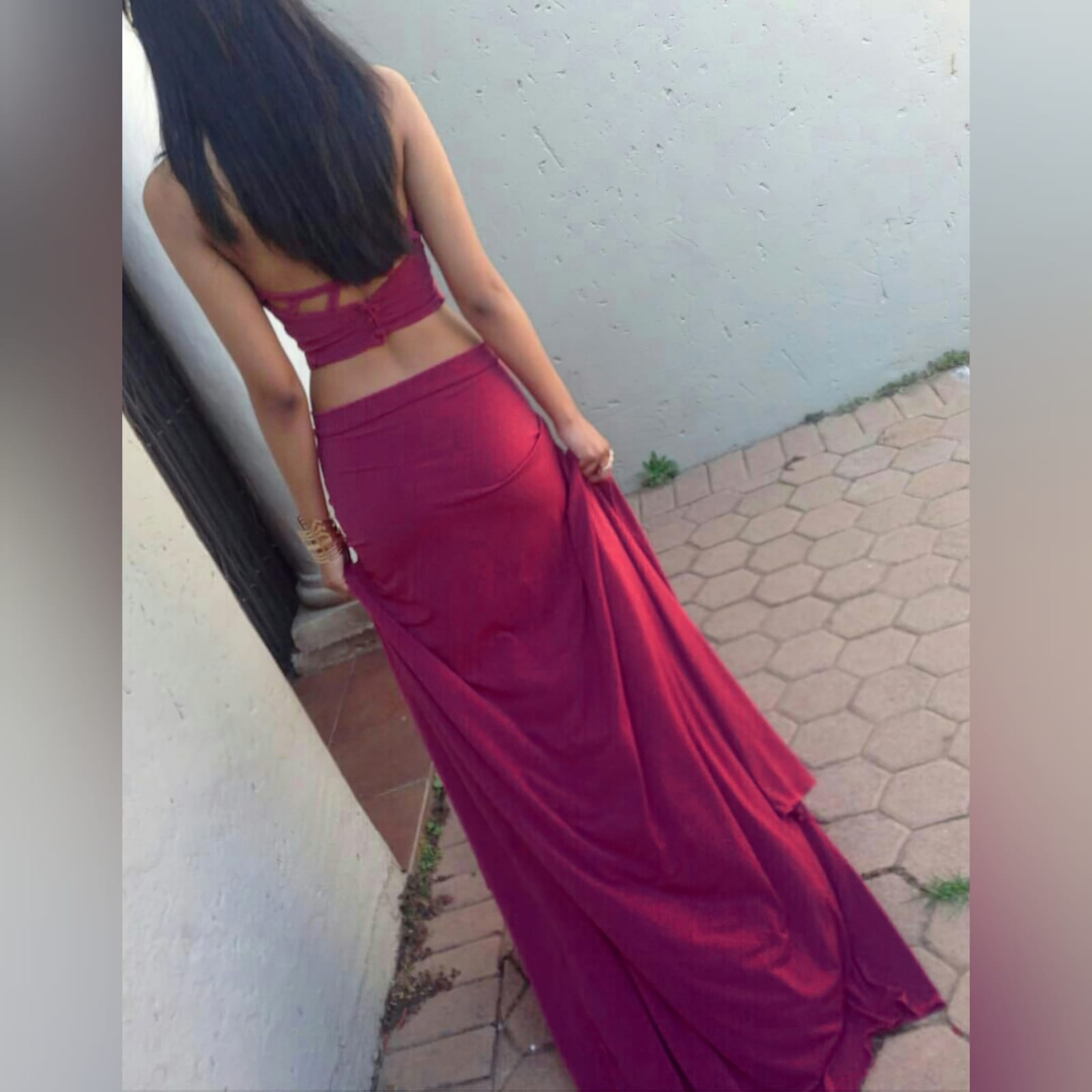 2 piece plum prom dance dress 2 2 piece plum prom dance dress. Halter neck crop top. Straps from the crop top create a cross that joins to the skirt. Skirt fitted till the hip and then very flowy with a long, wide train.