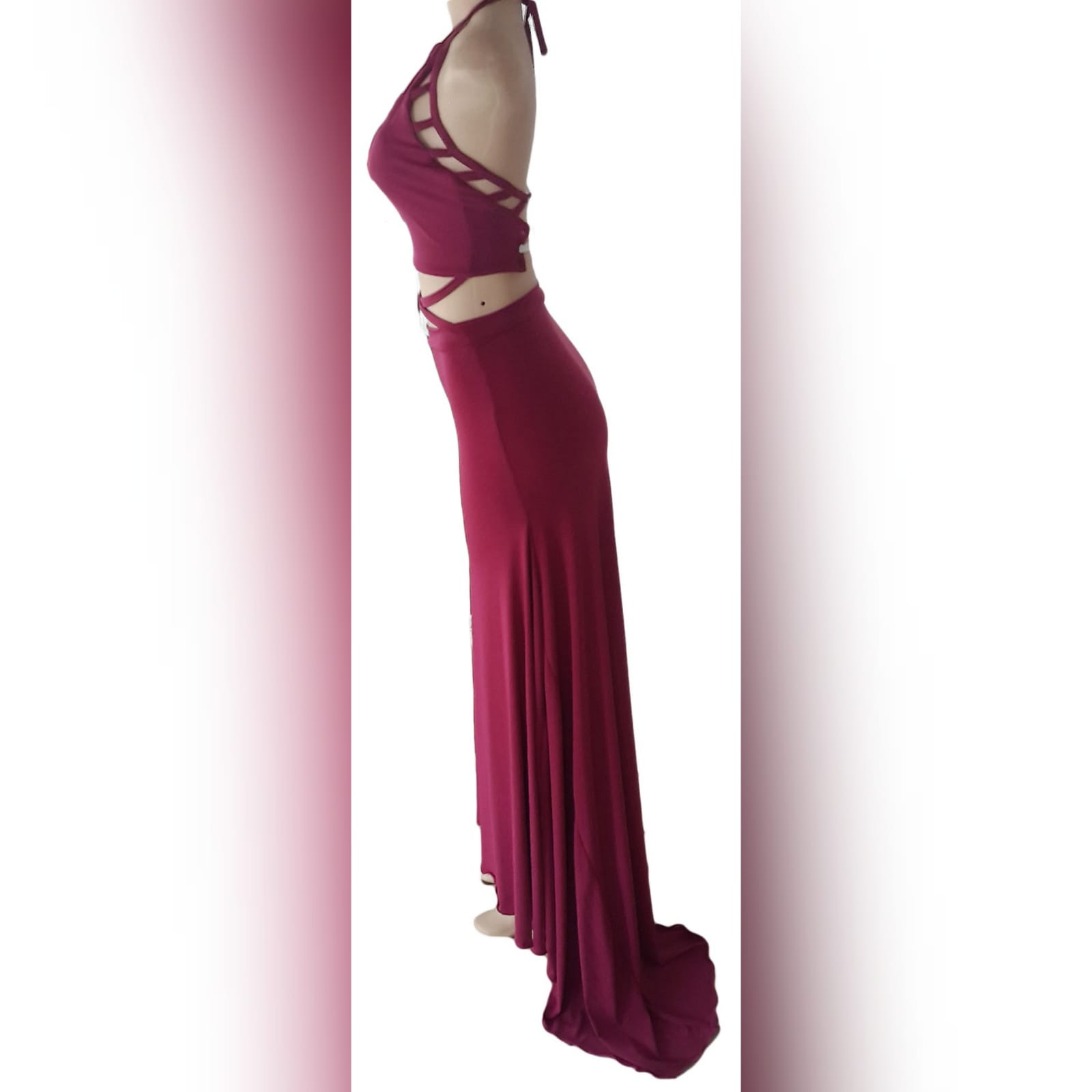 2 piece plum prom dance dress 7 2 piece plum prom dance dress. Halter neck crop top. Straps from the crop top create a cross that joins to the skirt. Skirt fitted till the hip and then very flowy with a long, wide train.