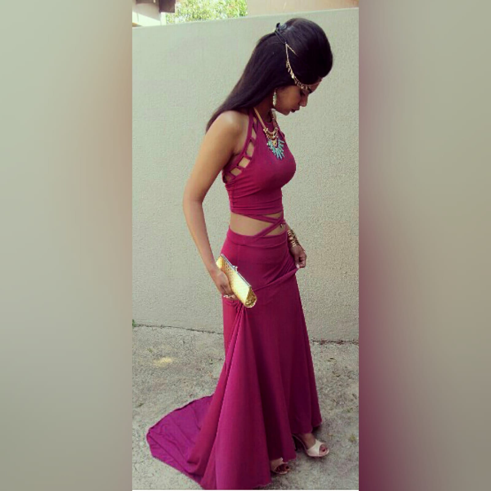 2 piece plum prom dance dress 3 2 piece plum prom dance dress. Halter neck crop top. Straps from the crop top create a cross that joins to the skirt. Skirt fitted till the hip and then very flowy with a long, wide train.
