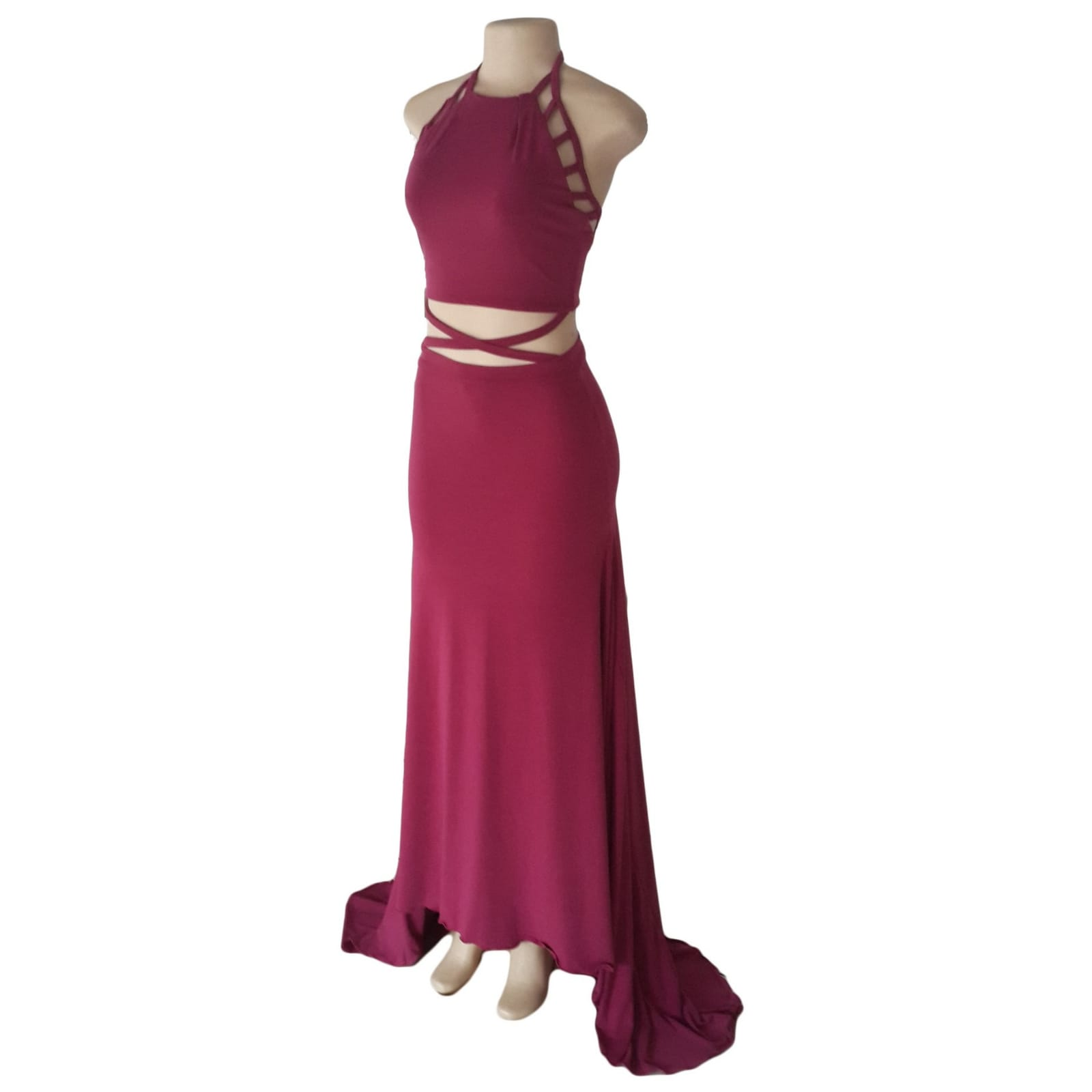2 piece plum prom dance dress 6 2 piece plum prom dance dress. Halter neck crop top. Straps from the crop top create a cross that joins to the skirt. Skirt fitted till the hip and then very flowy with a long, wide train.