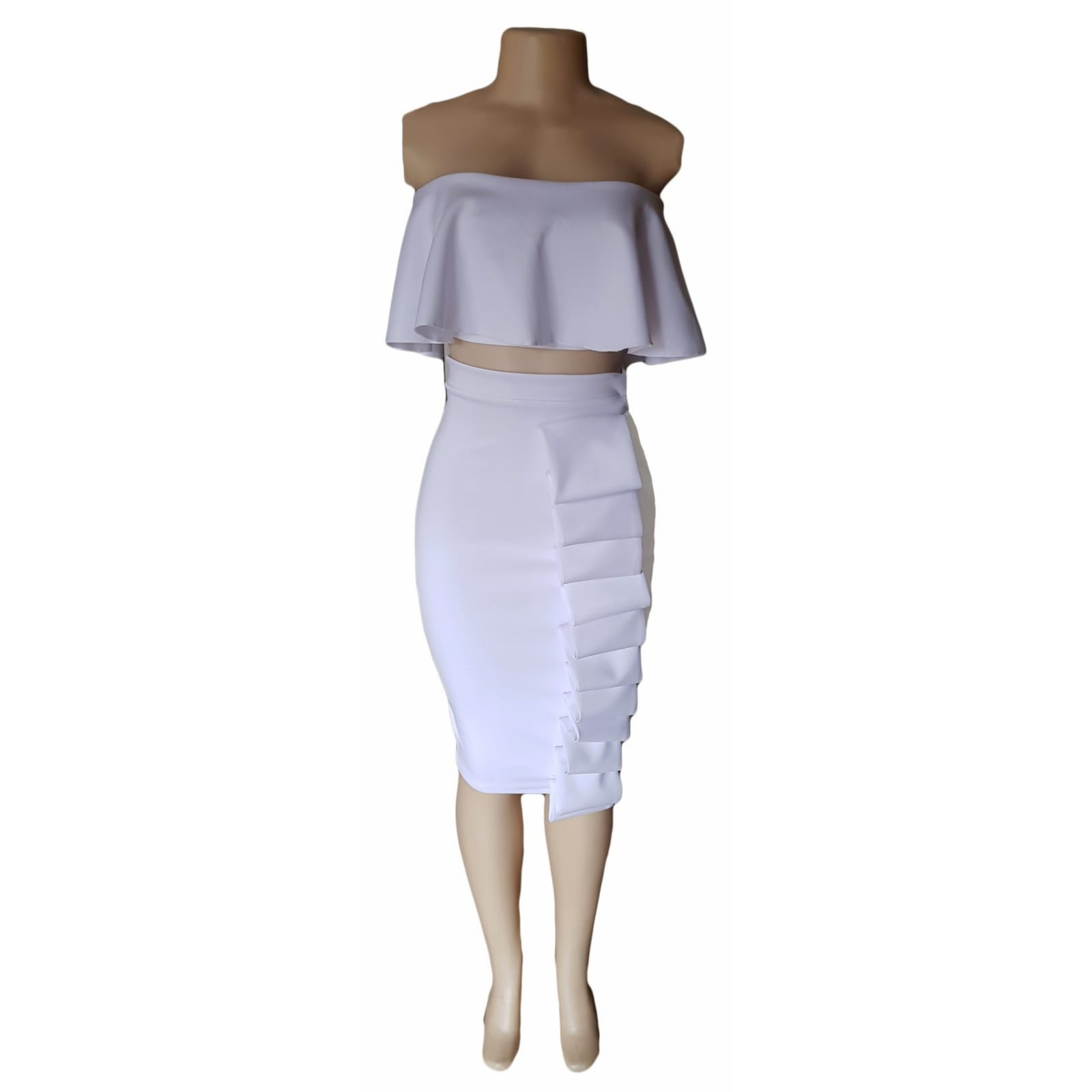 2 piece white smart casual wear 2 2 piece white smart casual wear. Crop boob tube frilled top with tight fitting below the knee skirt detailed with folds.
