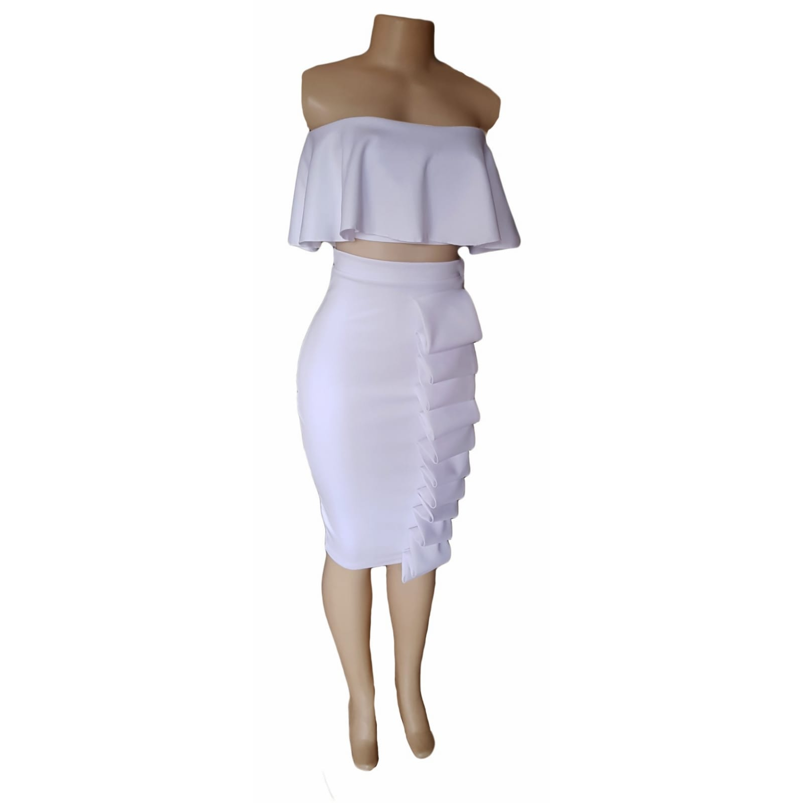 2 piece white smart casual wear 1 2 piece white smart casual wear. Crop boob tube frilled top with tight fitting below the knee skirt detailed with folds.
