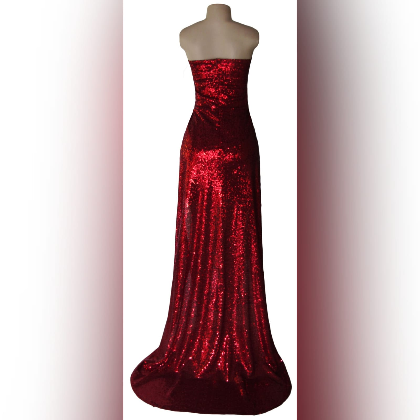 21st birthday party evening dress in red 4 red fully sequins evening dress for a 21st birthday party. The dress creates the illusion of a 2 piece with a cross busted bodice showing tummy, a short pencil skirt with a back overlayer creating a train.