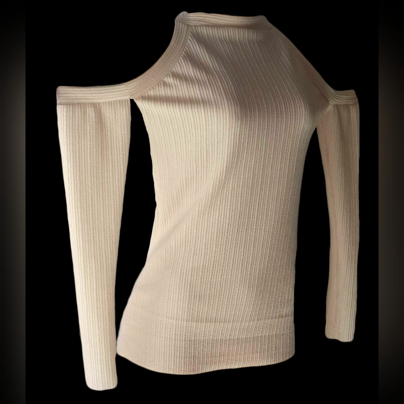 Beige winter knitted smart casual top 1 beige winter knitted smart casual top, with off shoulder long sleeves
