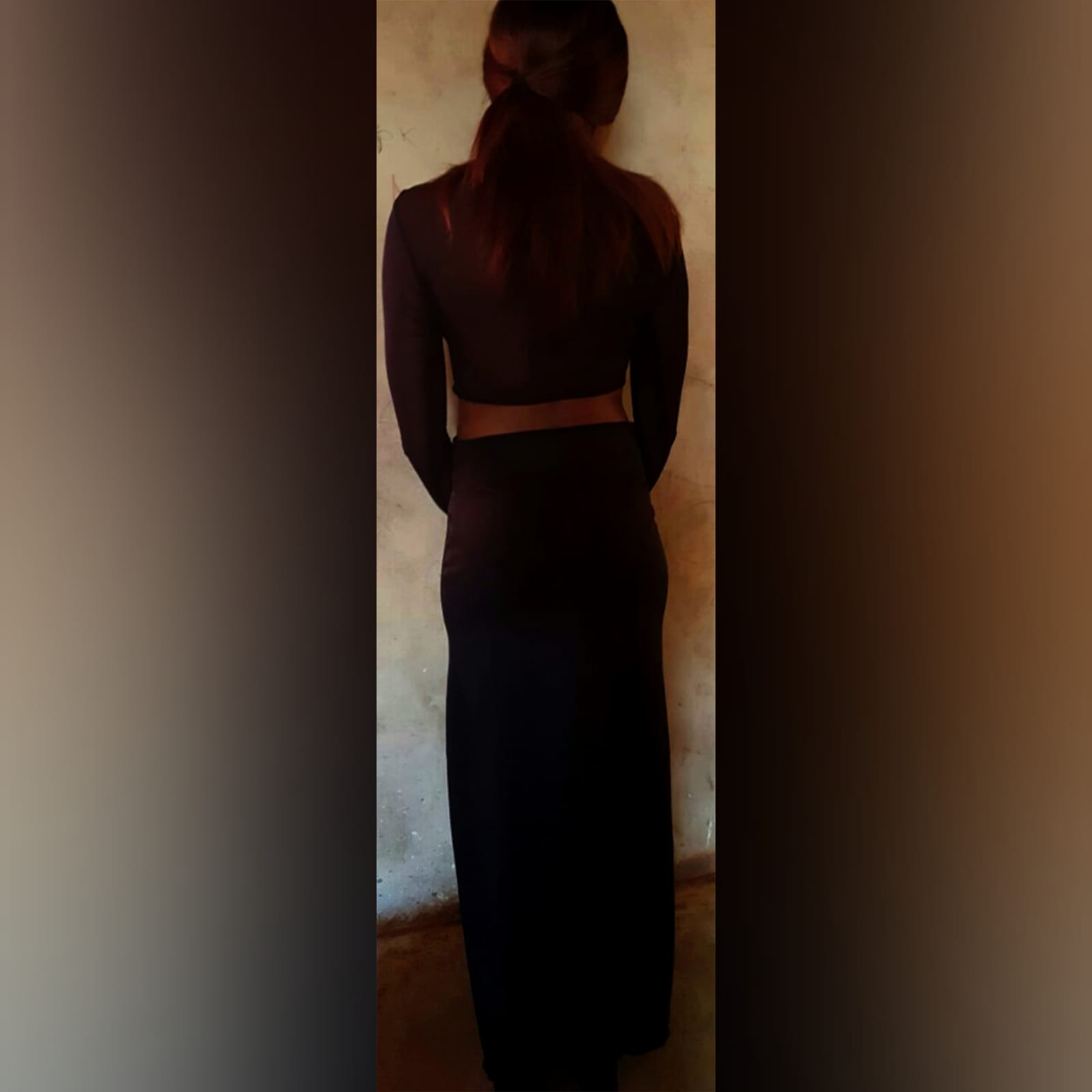 Black 2 piece smart casual dress 3 black 2 piece smart casual dress, with a crop top with long mesh sleeves, with a pencil long skirt with a slit