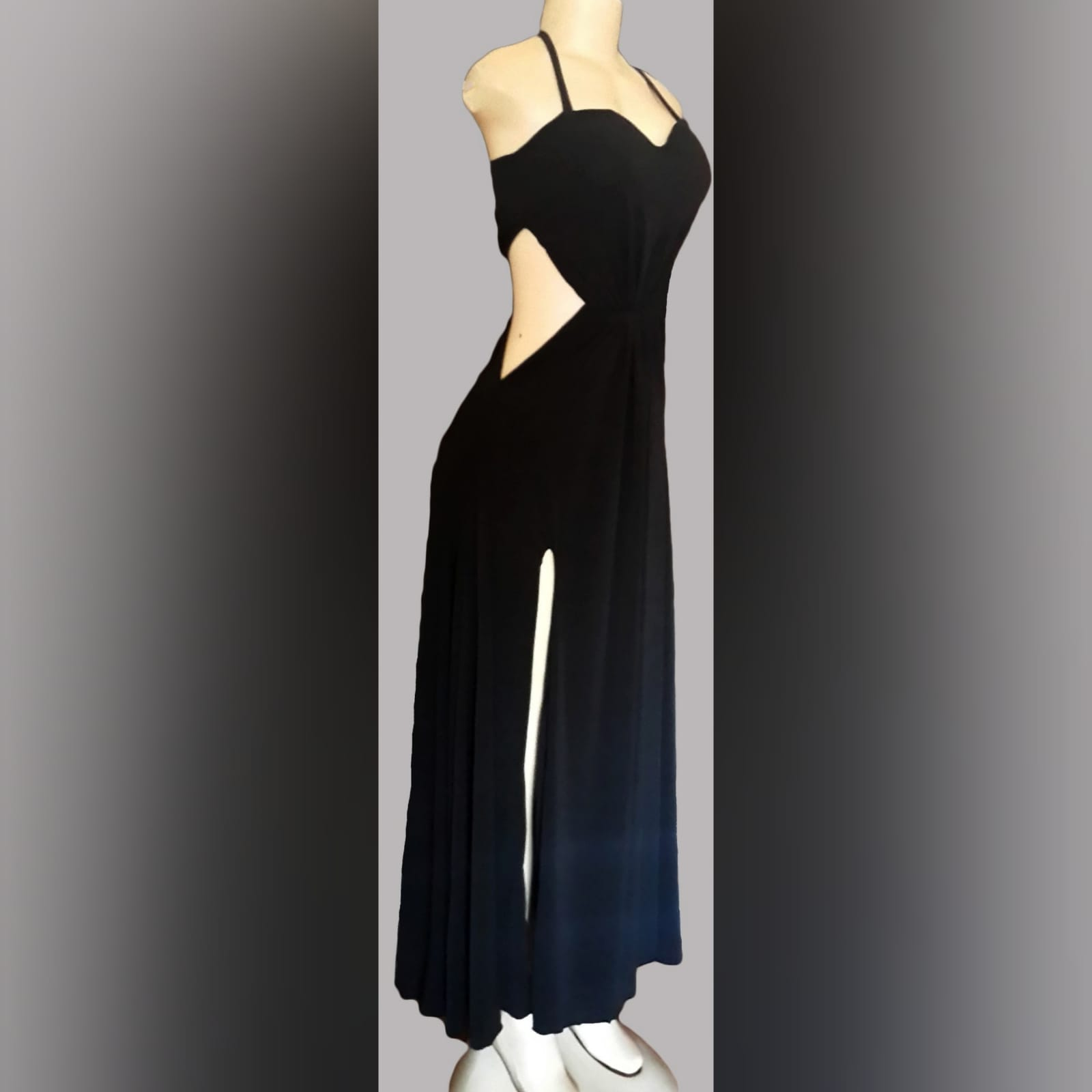Black long flowy evening dress 1 black long flowy evening dress with side tummy openings, a slit and halter neck string