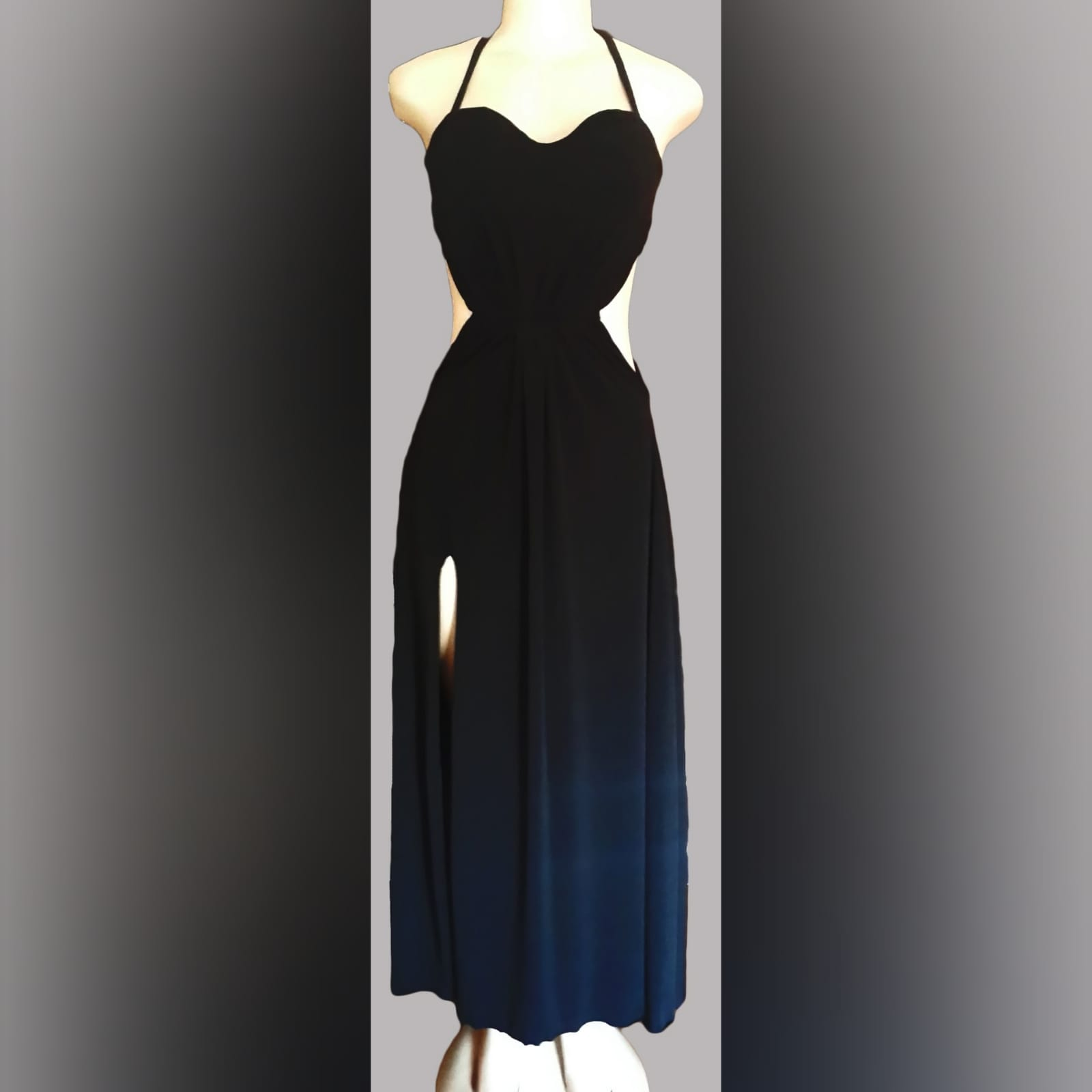 Black long flowy evening dress 4 black long flowy evening dress with side tummy openings, a slit and halter neck string