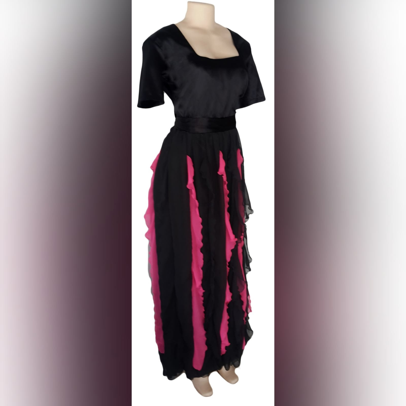 Black and pink evening dress 1 black & pink evening dress with square neckline short sleeves & vertical pink and black frills