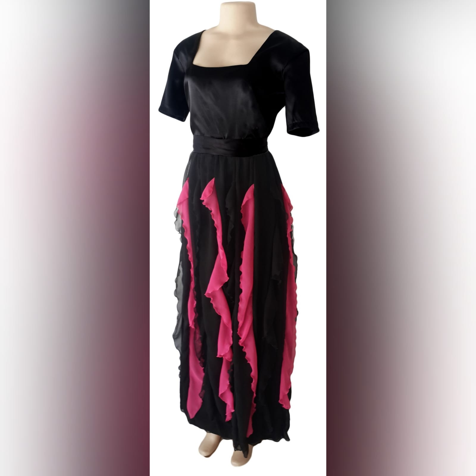 Black and pink evening dress 2 black & pink evening dress with square neckline short sleeves & vertical pink and black frills