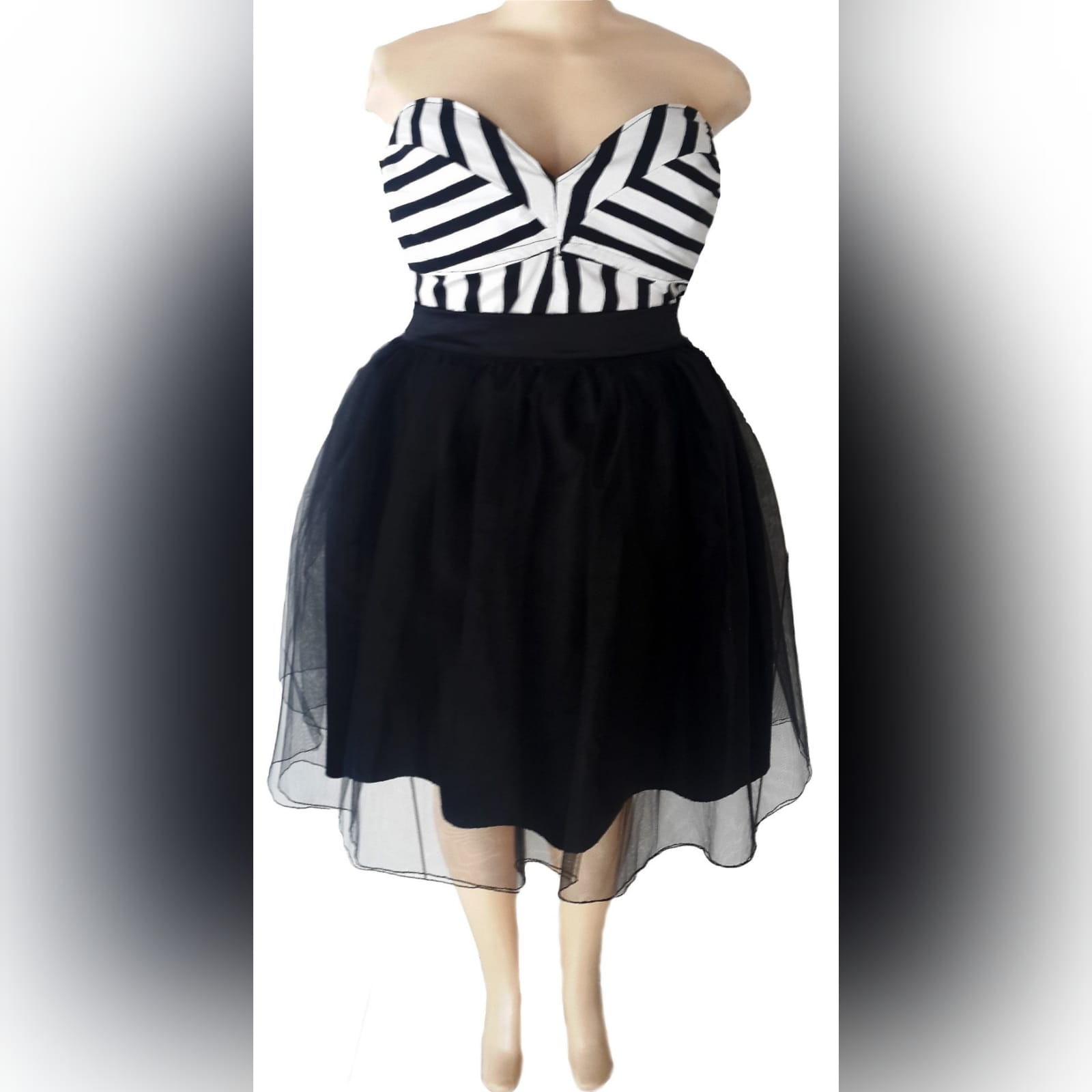 Black and white boob tube tutu smart casual dress 3 black and white boob tube tutu smart casual dress, under the knee length with a striped bodice.