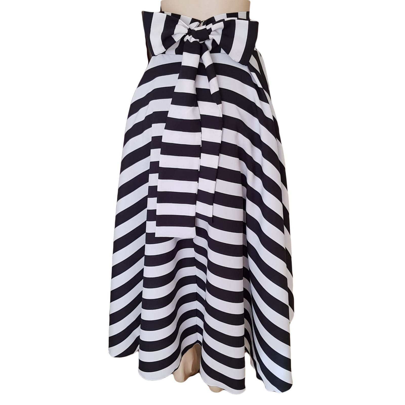 Black and white horizontal striped smart casual skirt 3 black and white horizontal striped high low, high waist smart casual skirt with bow detail on the back.