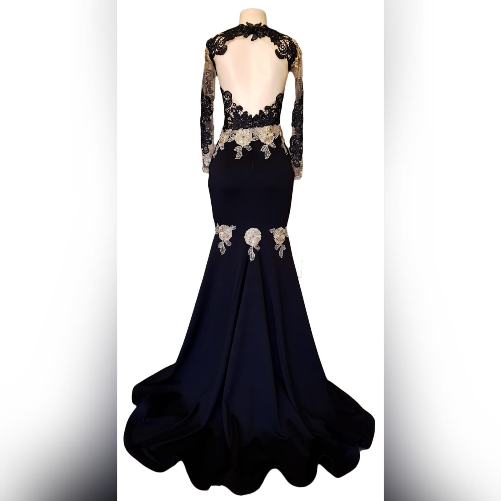Black & gold soft mermaid prom dress 7 black & gold soft mermaid prom dress with an illusion lace bodice and long sleeves. With an open back and a train. Lace detailed with beads.