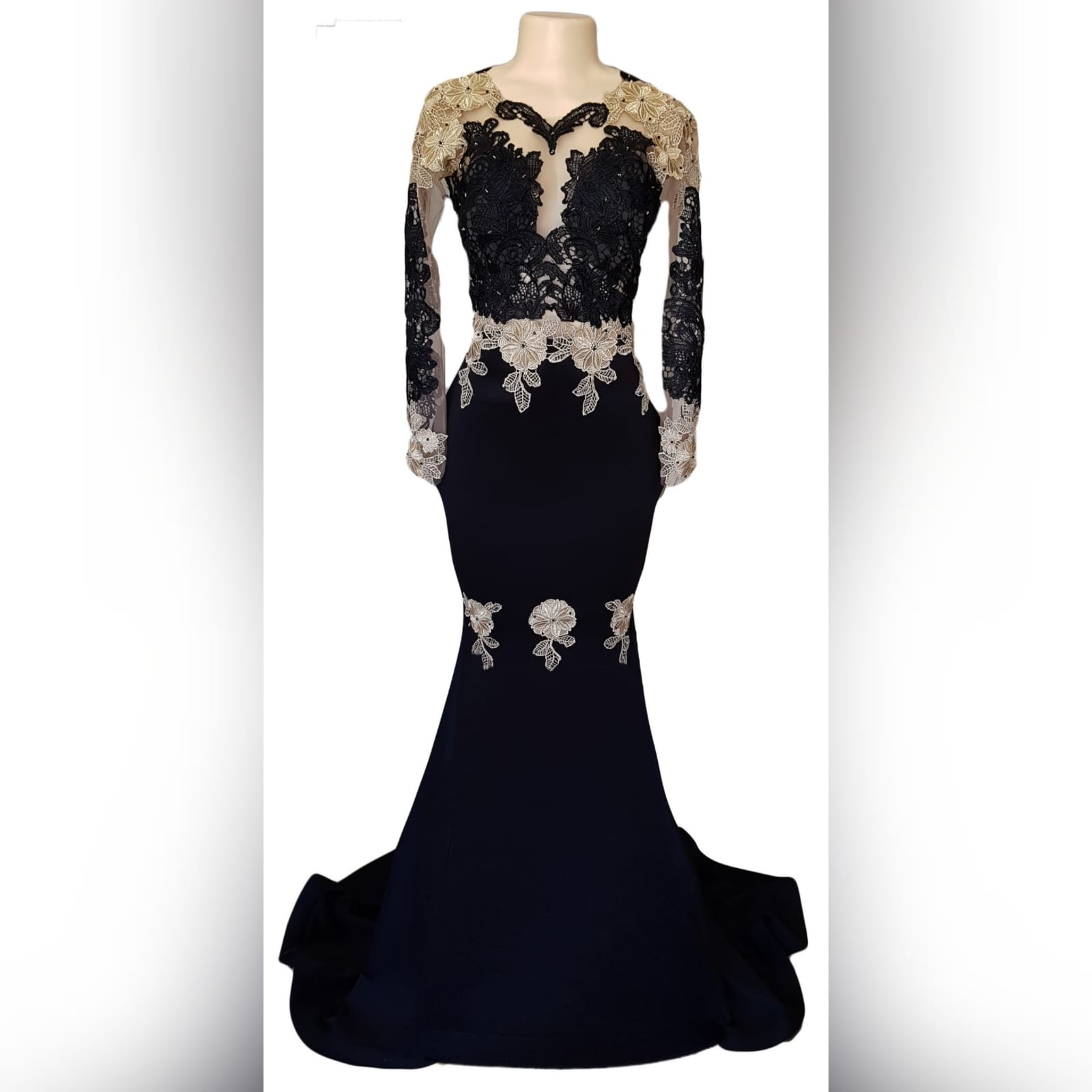 Black & gold soft mermaid prom dress 8 black & gold soft mermaid prom dress with an illusion lace bodice and long sleeves. With an open back and a train. Lace detailed with beads.