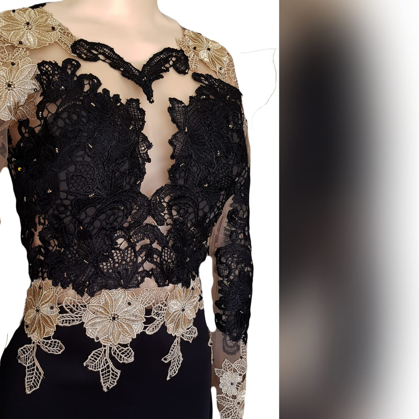Black & gold soft mermaid prom dress 3 black & gold soft mermaid prom dress with an illusion lace bodice and long sleeves. With an open back and a train. Lace detailed with beads.