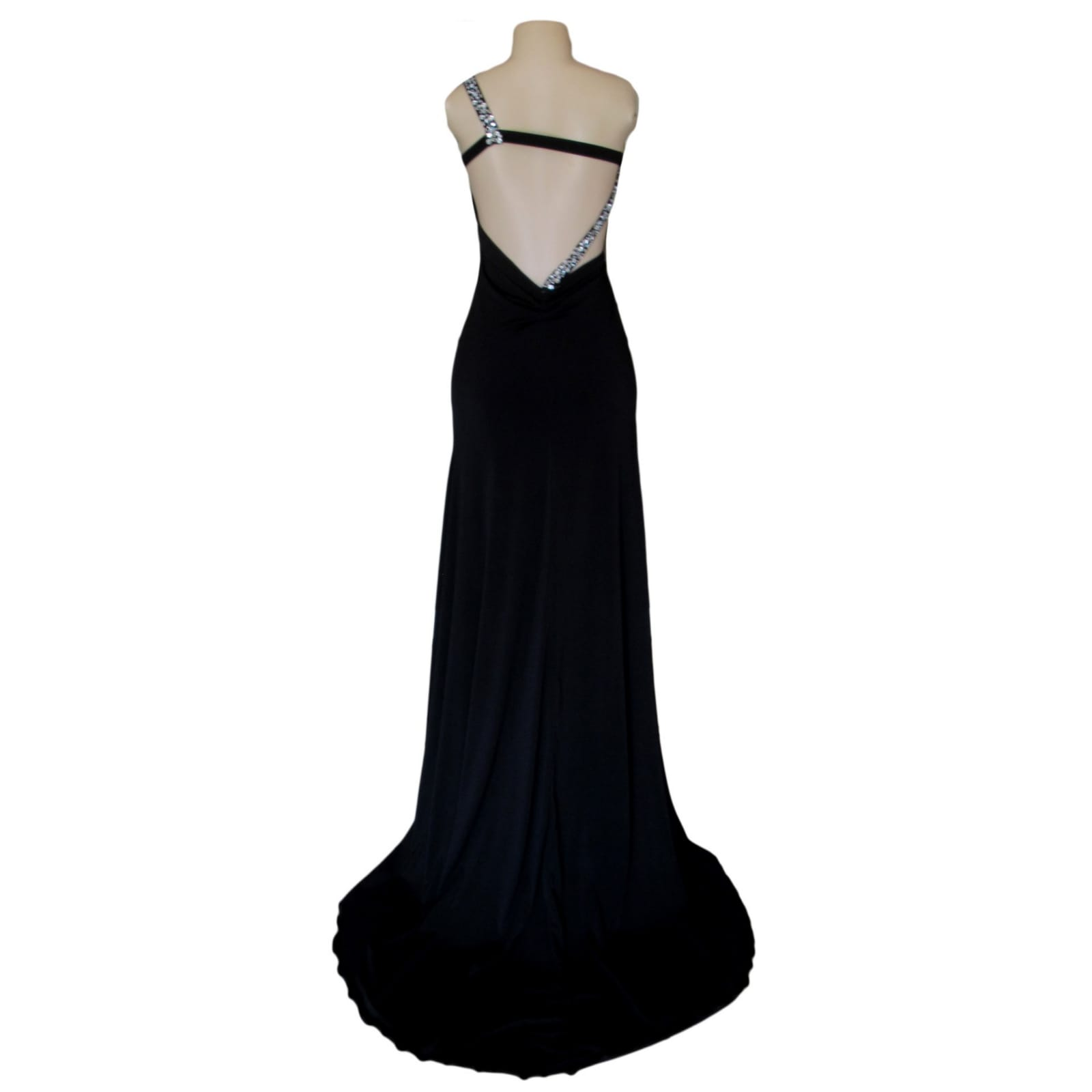 Black long formal dress with a low open back 5 black long formal dress with a low open back. Shoulder strap design detailed with silver beads and a slit.