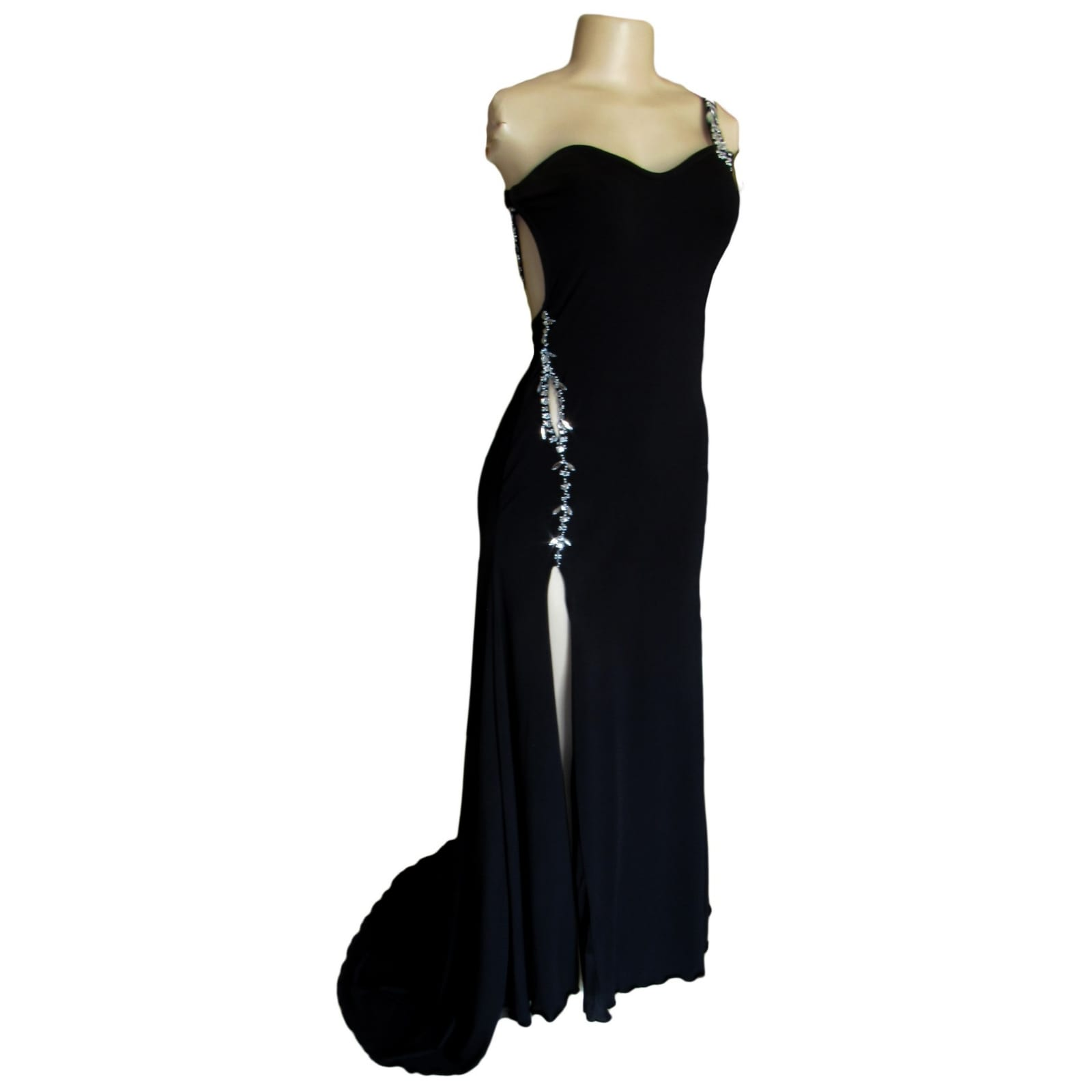 Black long formal dress with a low open back 1 black long formal dress with a low open back. Shoulder strap design detailed with silver beads and a slit.