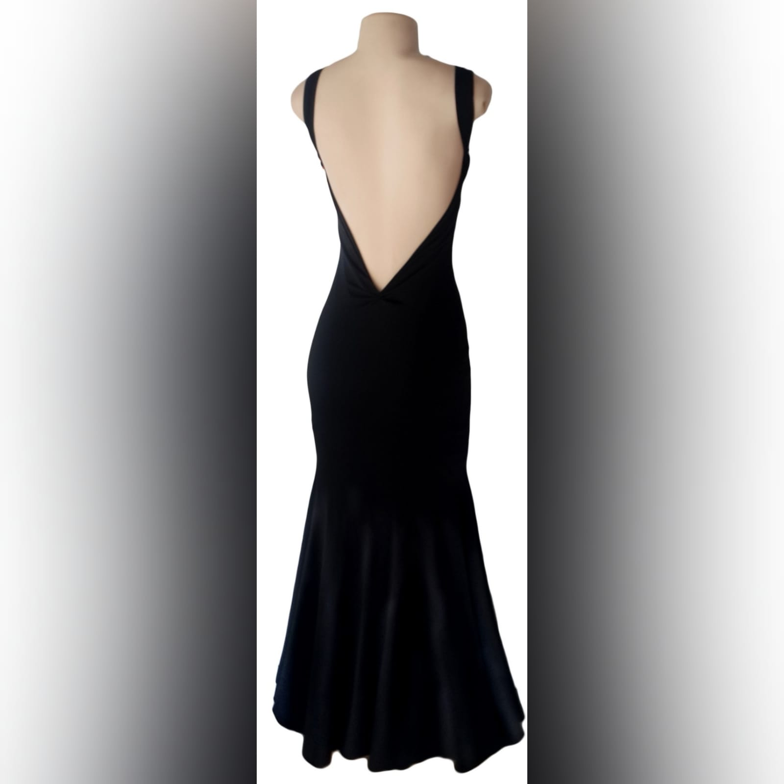 Black sexy evening dress fitted till the hip 3 black sexy evening dress fitted till the hip, with a low v open back. Straps with a sweetheart neckline.