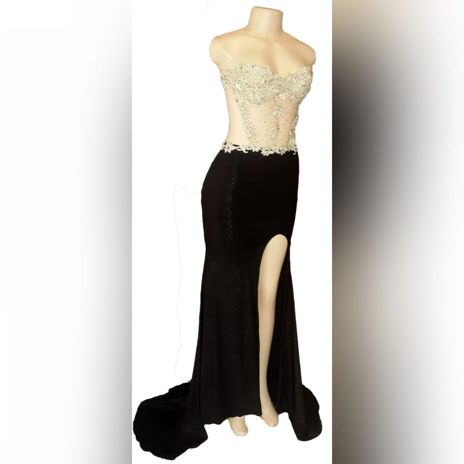 Black shimmer and gold pageant evening dress 5 black shimmer and gold pageant evening dress, with a naked back effect with strap detail, sheer tummy, with a slit and a train.