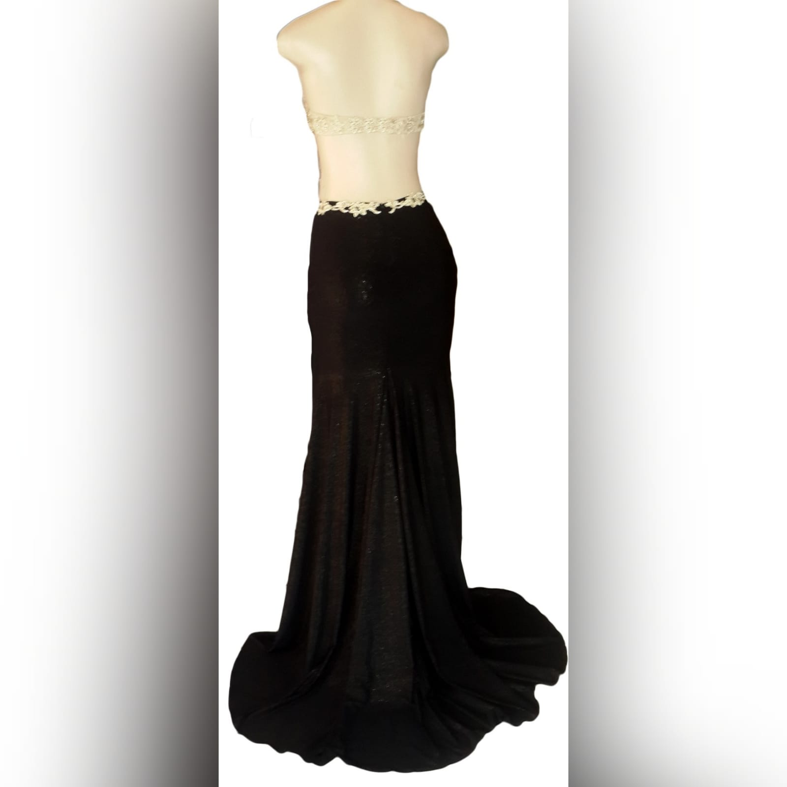 Black shimmer and gold pageant evening dress 6 black shimmer and gold pageant evening dress, with a naked back effect with strap detail, sheer tummy, with a slit and a train.