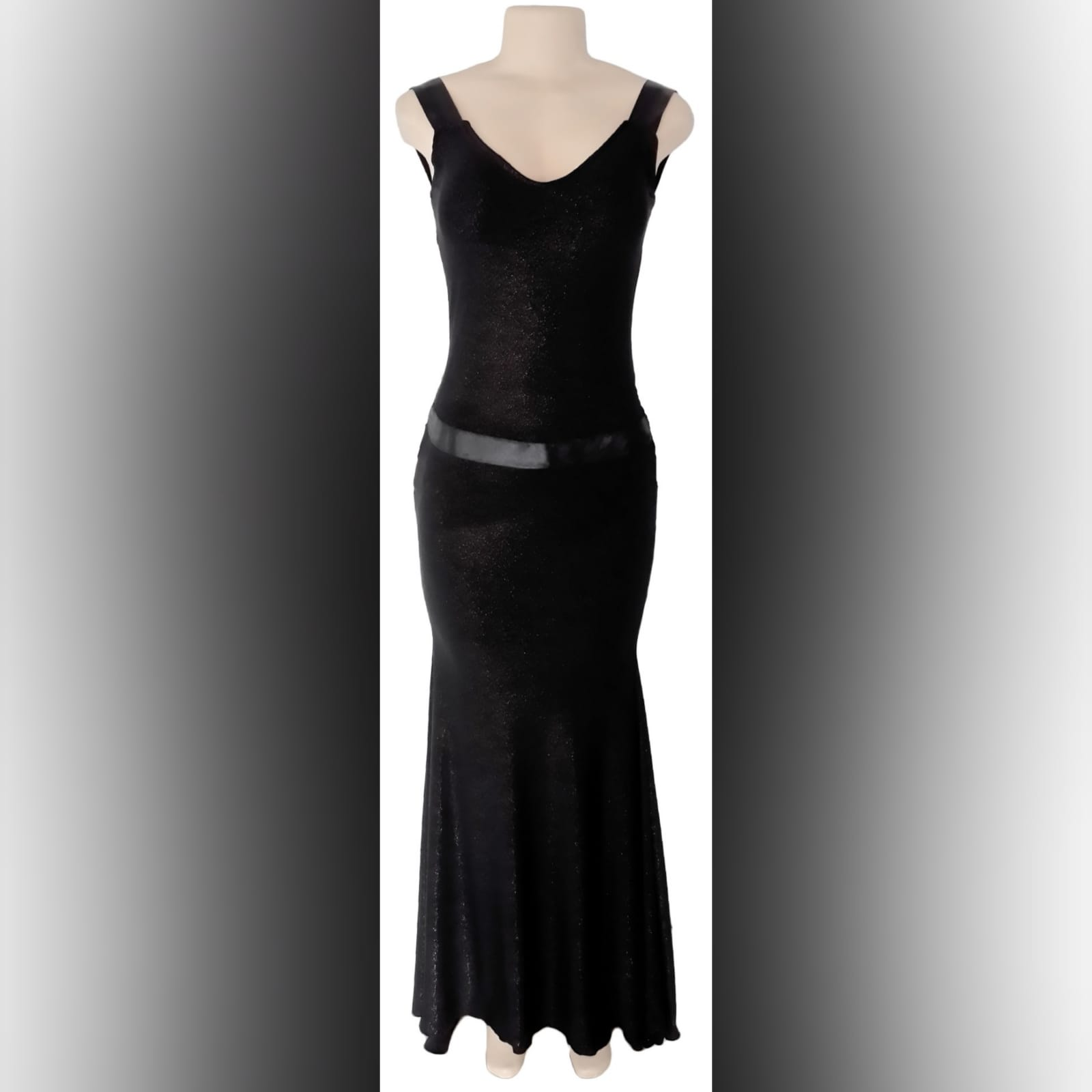 Black shimmer long gala evening dress 3 black shimmer long gala evening dress, with a low v open back. With ribbon creating a belt and a cross at the back
