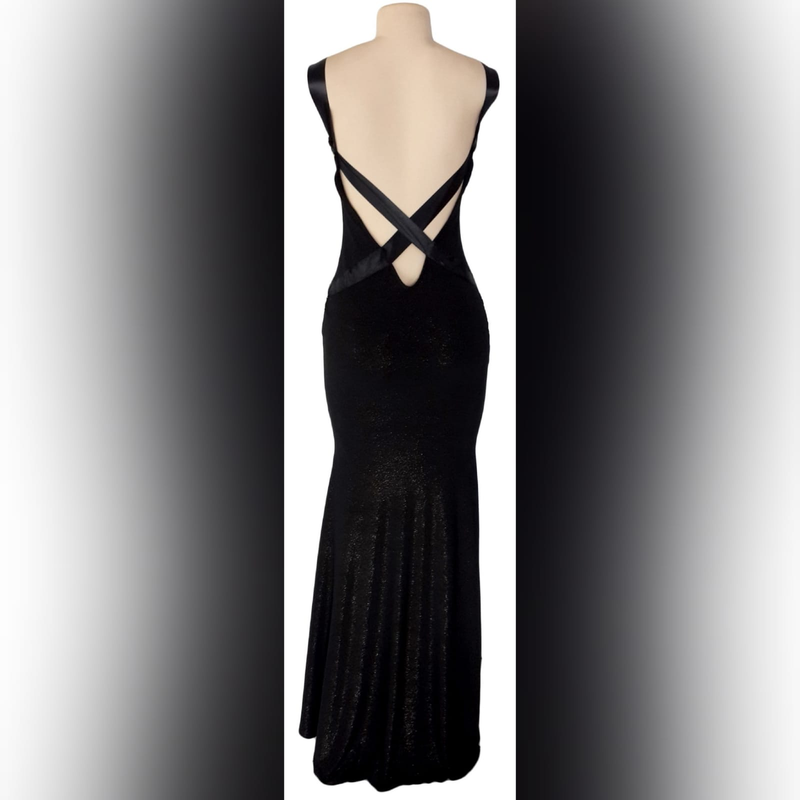 Black shimmer long gala evening dress 1 black shimmer long gala evening dress, with a low v open back. With ribbon creating a belt and a cross at the back