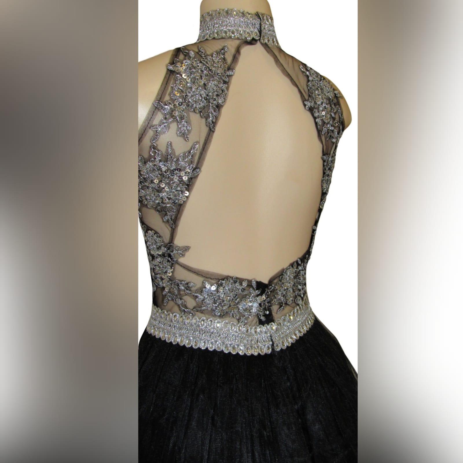 Black & silver long elegant prom dress 3 black & silver, long & elegant prom dance dress with a triangular open back. Choker neckline and an under bust bling belt with train.