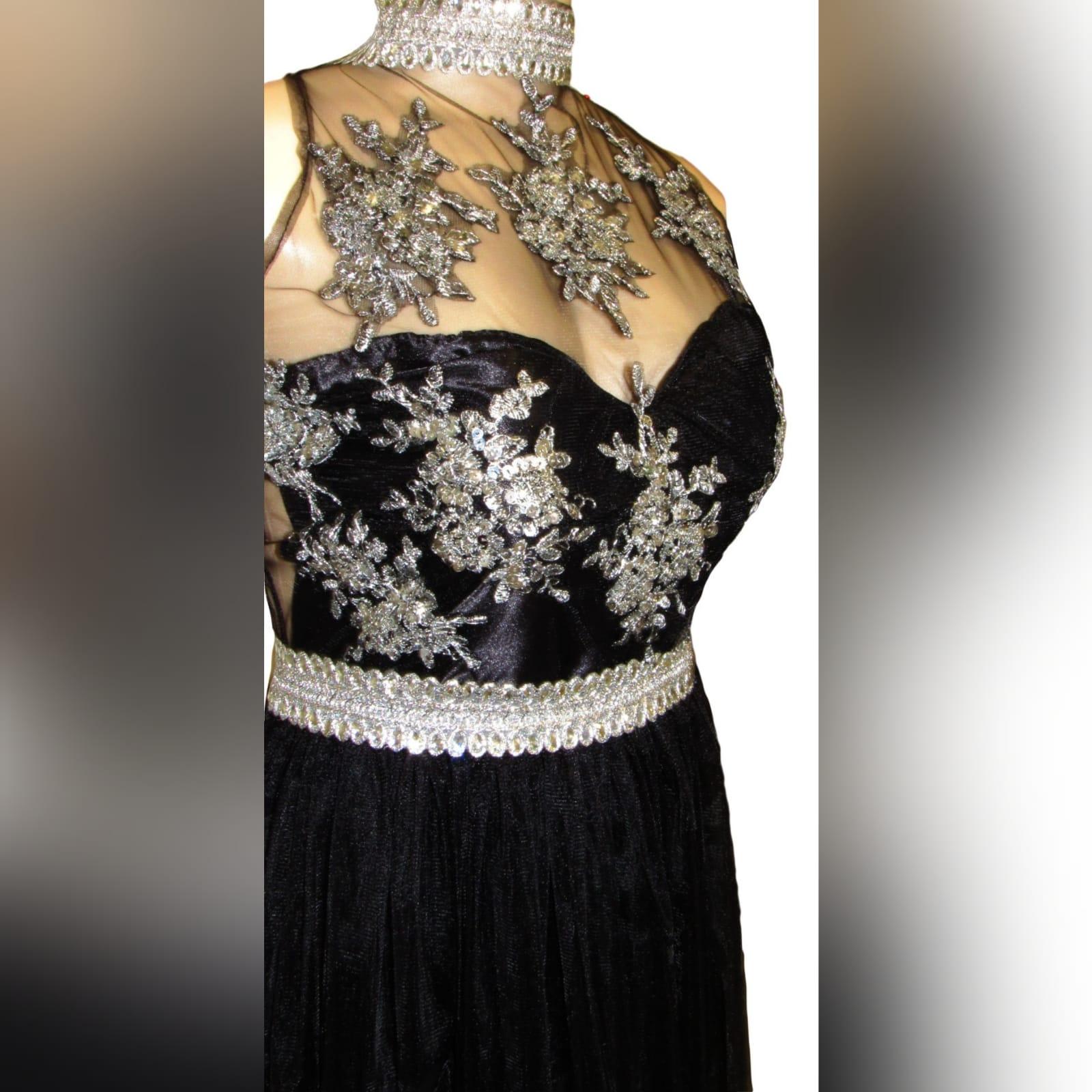 Black & silver long elegant prom dress 2 black & silver, long & elegant prom dance dress with a triangular open back. Choker neckline and an under bust bling belt with train.