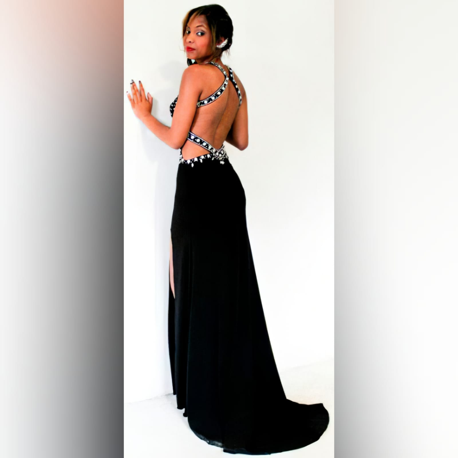Black and silver prom dress with a low open back 1 black & silver prom dress with a low open back, a slit and train. Slightly open on the side of the tummy. Back straps and bodice detailed with silver beads and diamante