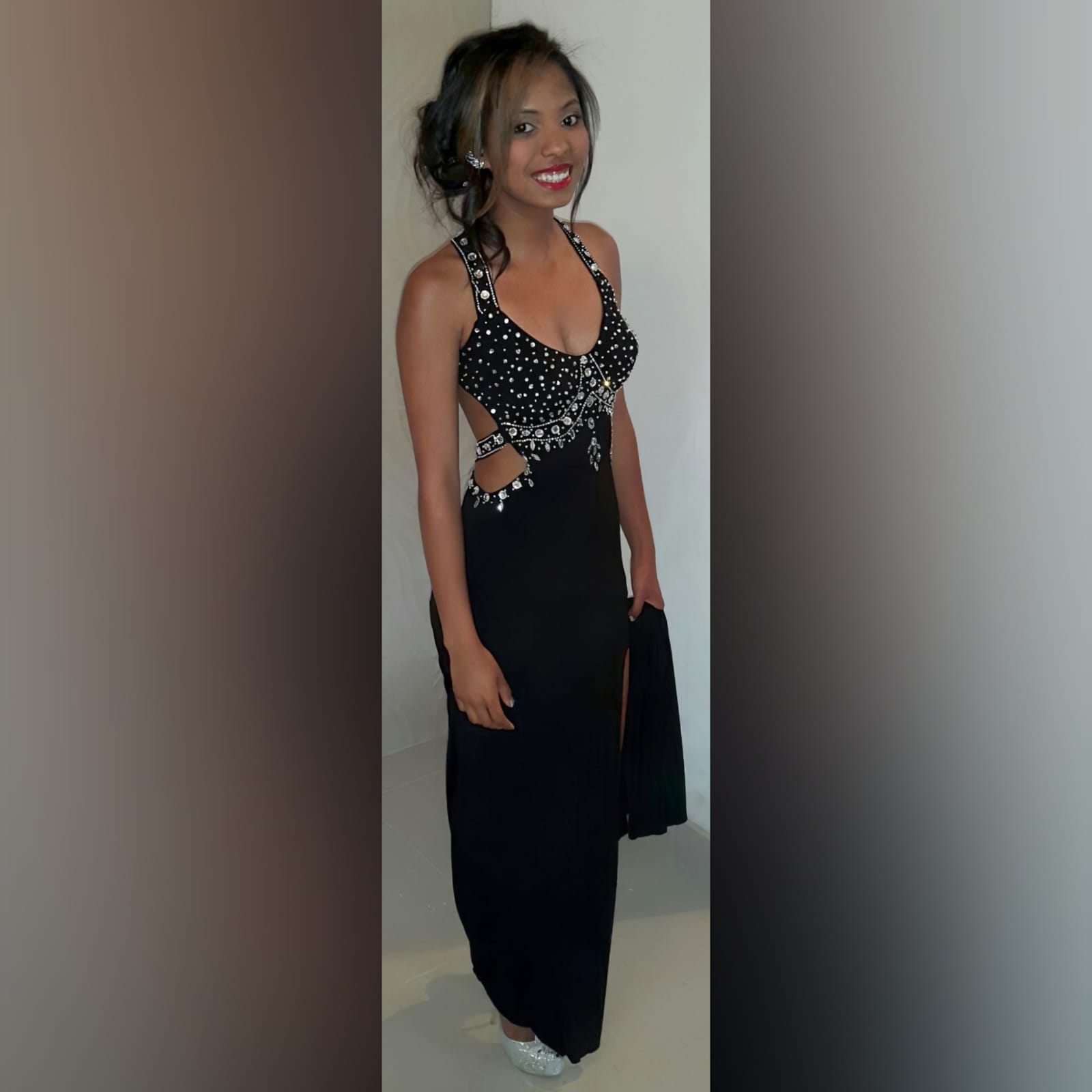 Black and silver prom dress with a low open back 2 black & silver prom dress with a low open back, a slit and train. Slightly open on the side of the tummy. Back straps and bodice detailed with silver beads and diamante
