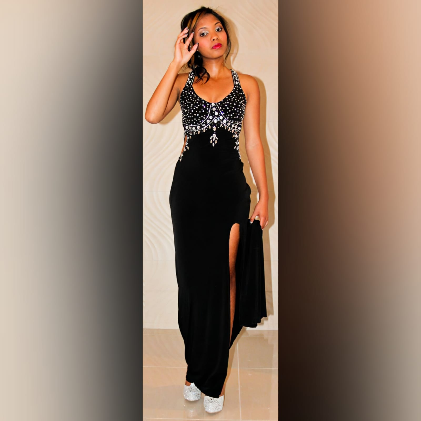 Black and silver prom dress with a low open back 3 black & silver prom dress with a low open back, a slit and train. Slightly open on the side of the tummy. Back straps and bodice detailed with silver beads and diamante