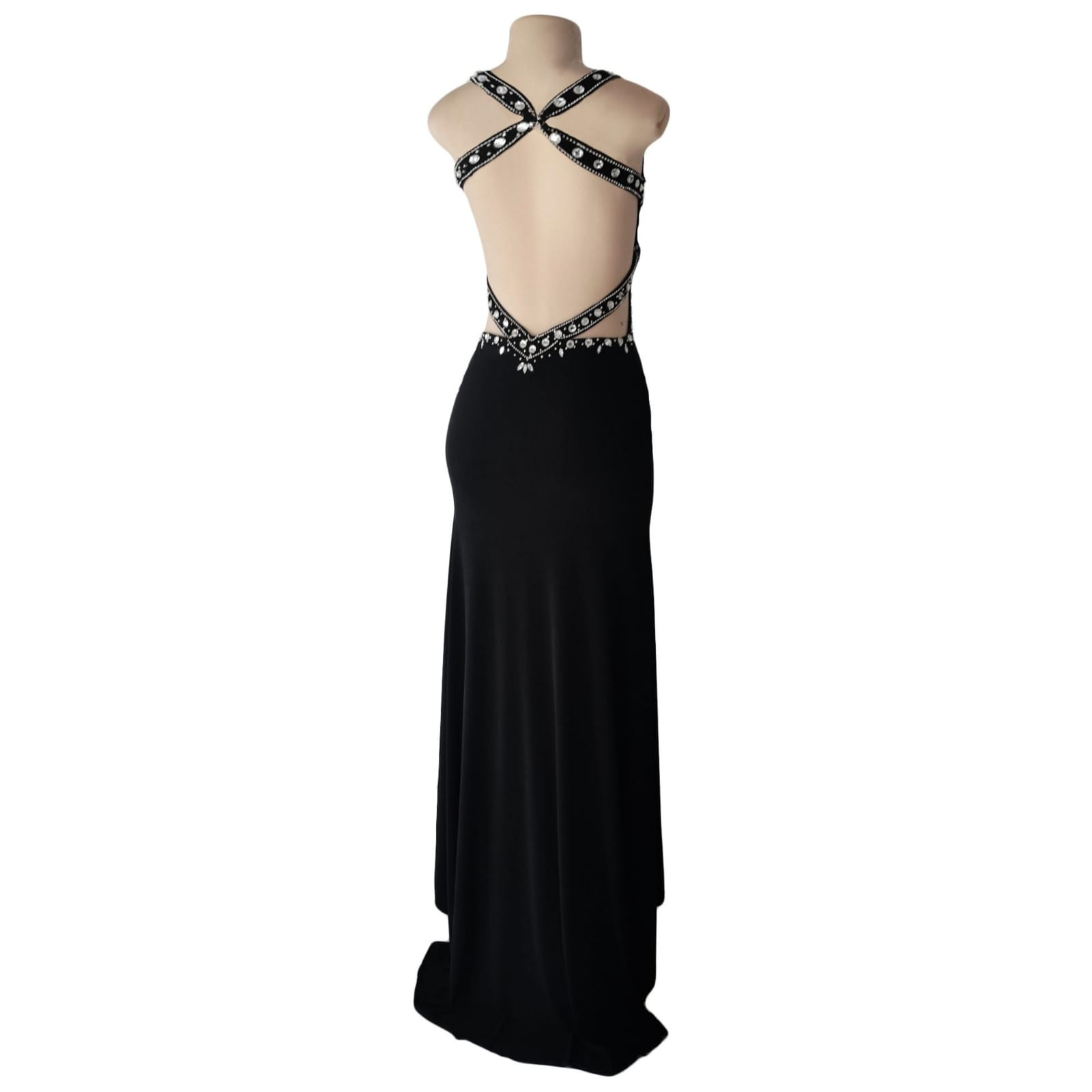 Black and silver prom dress with a low open back 5 black & silver prom dress with a low open back, a slit and train. Slightly open on the side of the tummy. Back straps and bodice detailed with silver beads and diamante