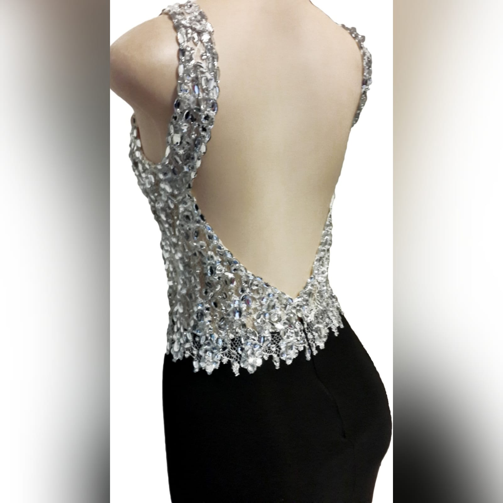 Black and silver prom dress with a slit and a train 7 black & silver prom dress with a slit and a train. Bodice with a sweetheart neckline and a low open back. With detailed silver beadwork through out the bodice