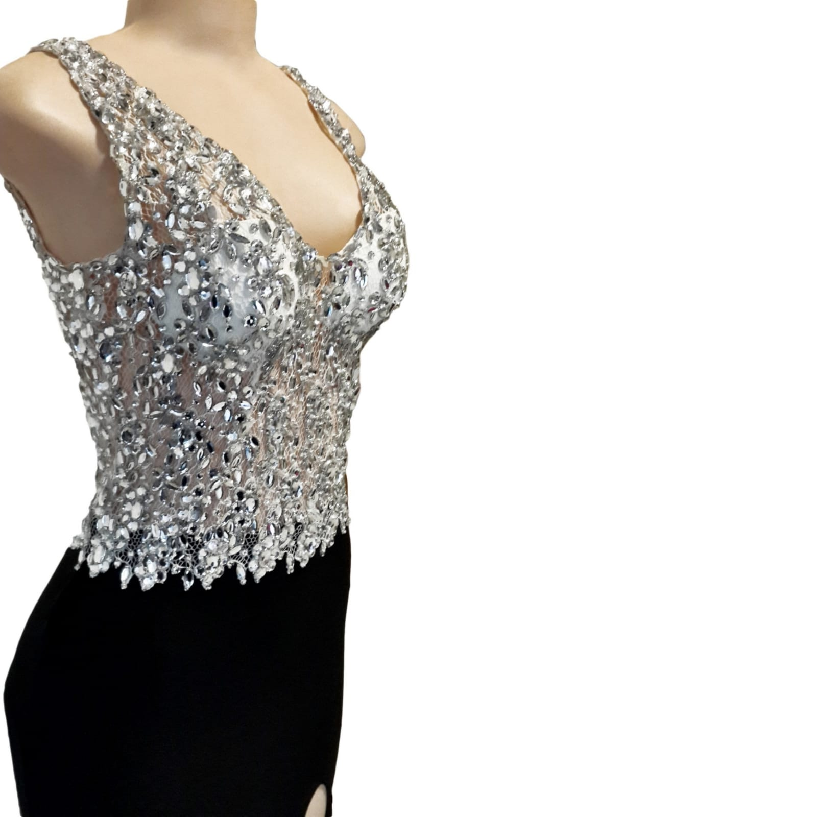 Black and silver prom dress with a slit and a train 5 black & silver prom dress with a slit and a train. Bodice with a sweetheart neckline and a low open back. With detailed silver beadwork through out the bodice