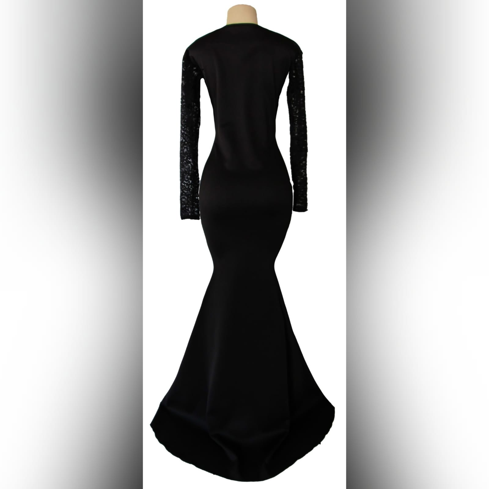 Black soft mermaid formal dress 3 black soft mermaid formal dress with sheer lace sleeves and a diamond shaped cleavage opening with a train.