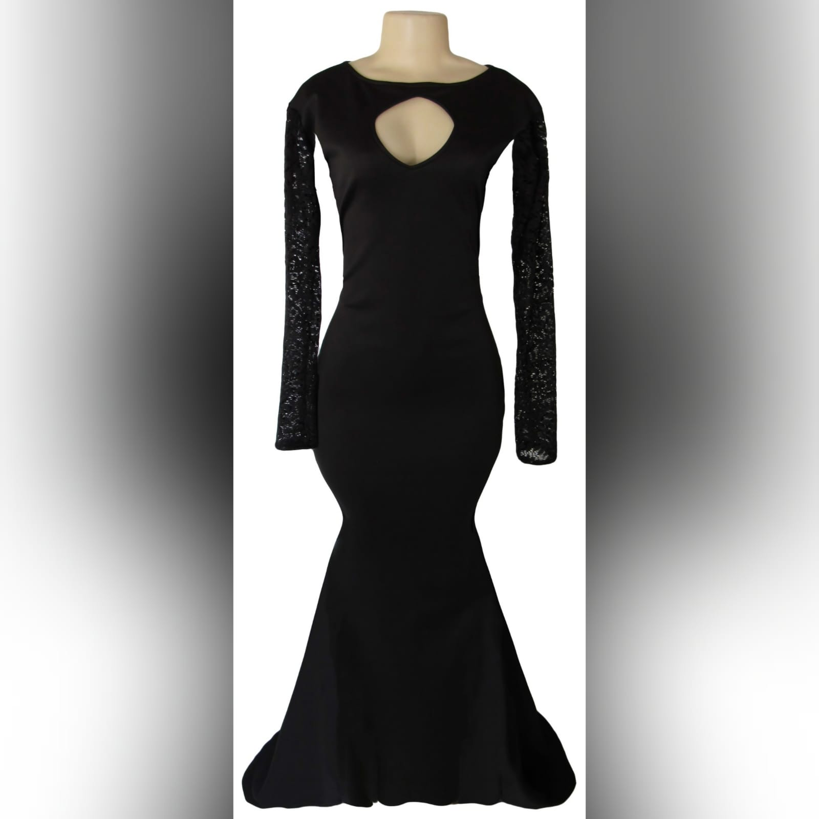 Black soft mermaid formal dress 1 black soft mermaid formal dress with sheer lace sleeves and a diamond shaped cleavage opening with a train.