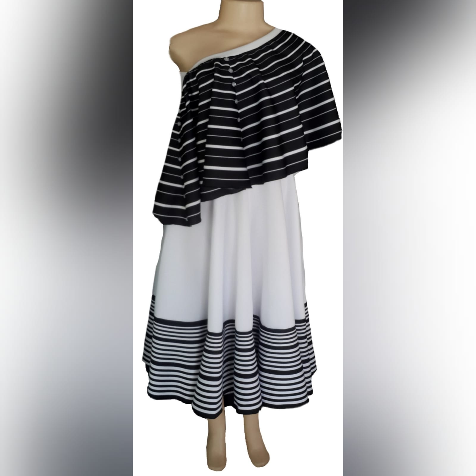 Black and white 2 piece modern traditional dress 1 xhosa black & white 2 piece modern traditional dress. Boob tube dress with a removable poncho