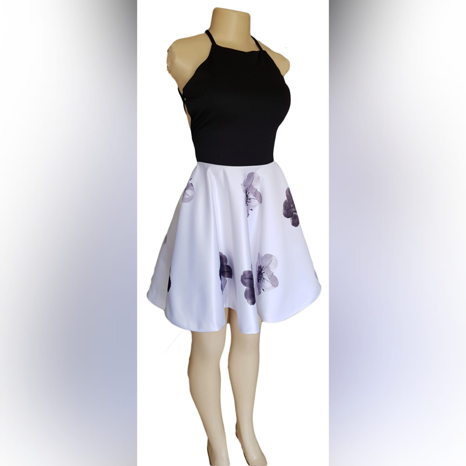 Black and white short open back smart casual dress 4 black & white short open back smart casual dress. Flowy bottom with printed flowers, black bodice with strap back lace up detail.
