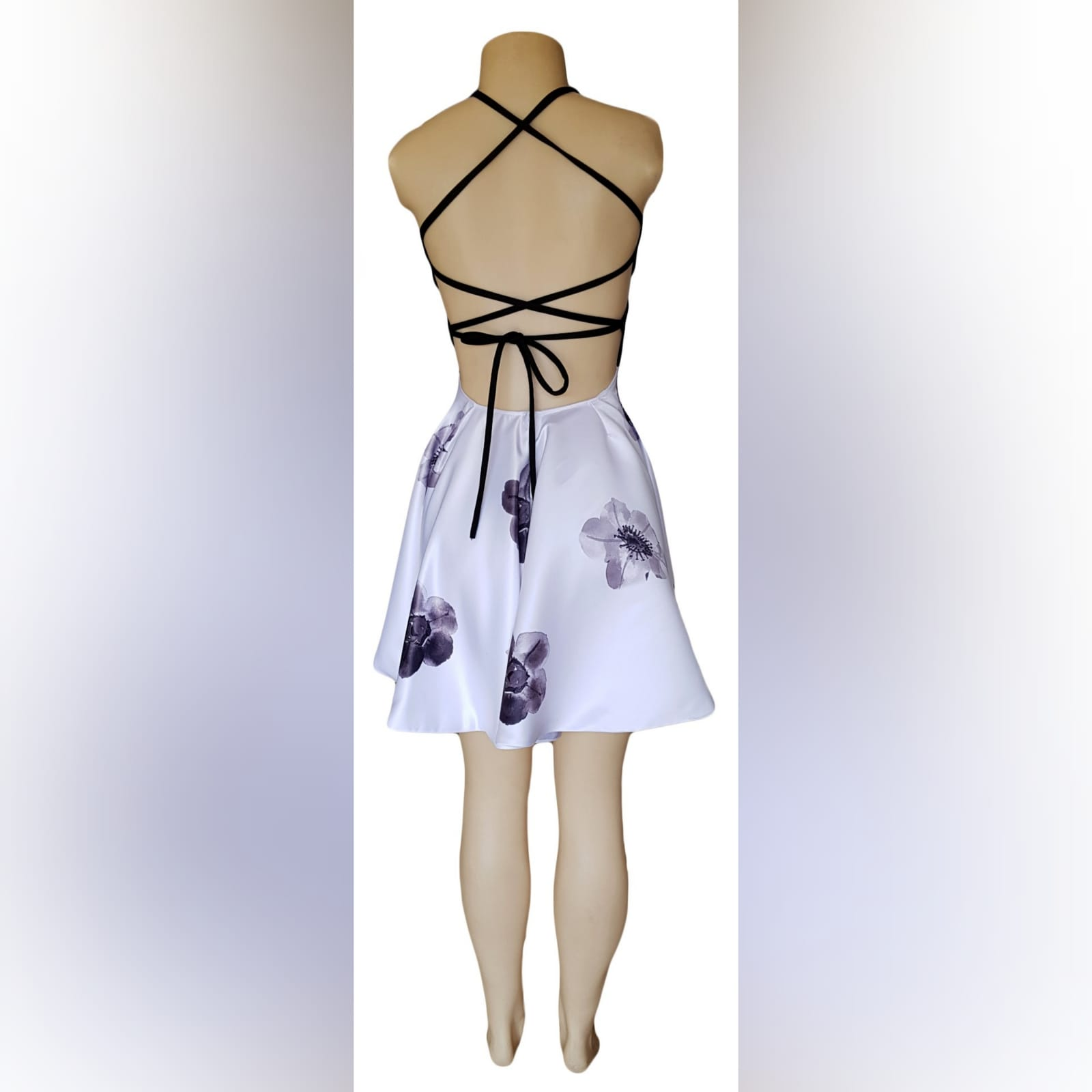 Black and white short open back smart casual dress 3 black & white short open back smart casual dress. Flowy bottom with printed flowers, black bodice with strap back lace up detail.