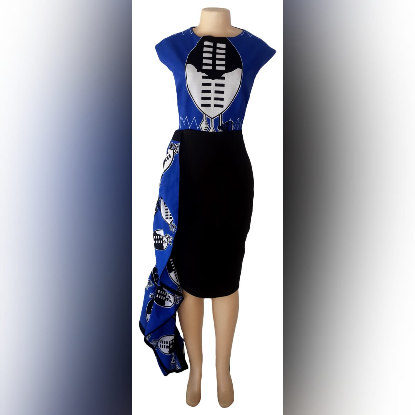Blue swati knee length dress with hip frill 8 modern traditional knee-length fitted swati dress in blue, black and white. With a hip frill. With matching black golf shirt detailed with swati fabric. Traditional wedding attire.