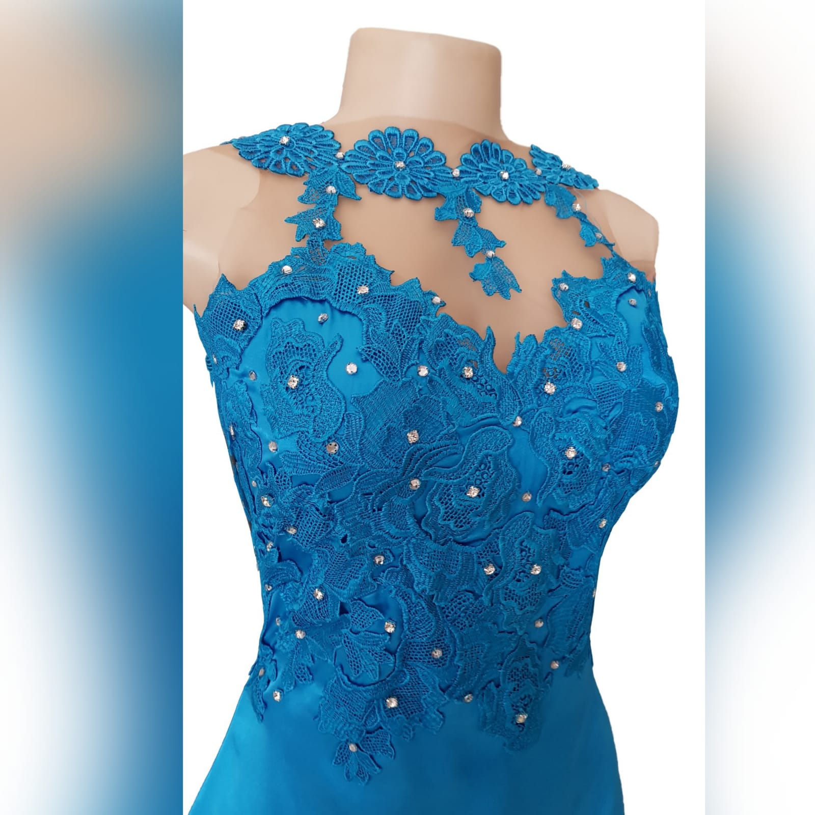 Blue long satin lace prom dress 3 blue long satin lace prom dress. Lace bodice with an illusion neckline and oval back opening with a slit and a train.