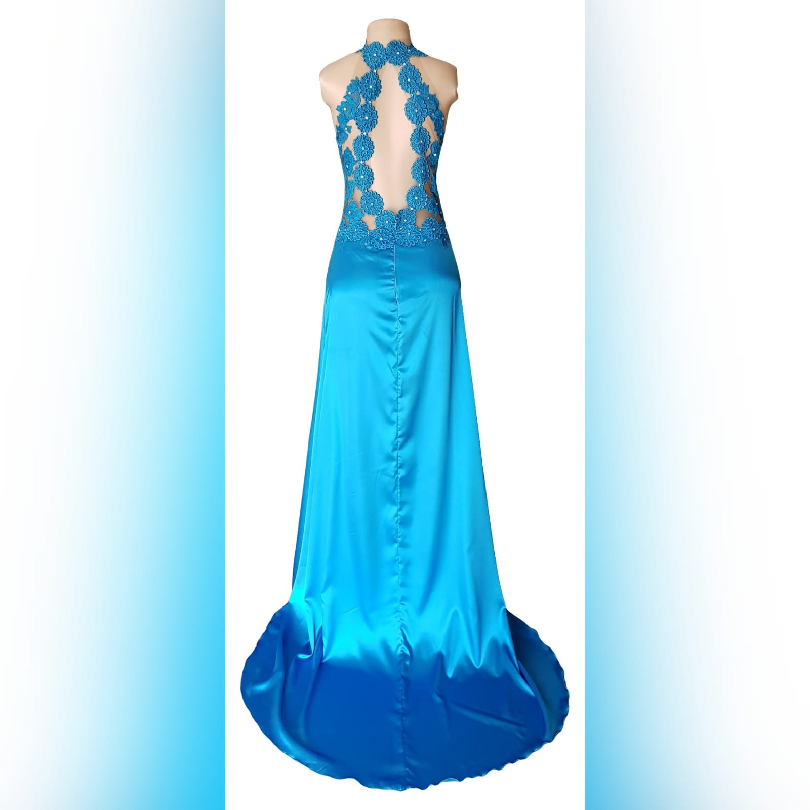 Blue long satin lace prom dress 4 blue long satin lace prom dress. Lace bodice with an illusion neckline and oval back opening with a slit and a train.