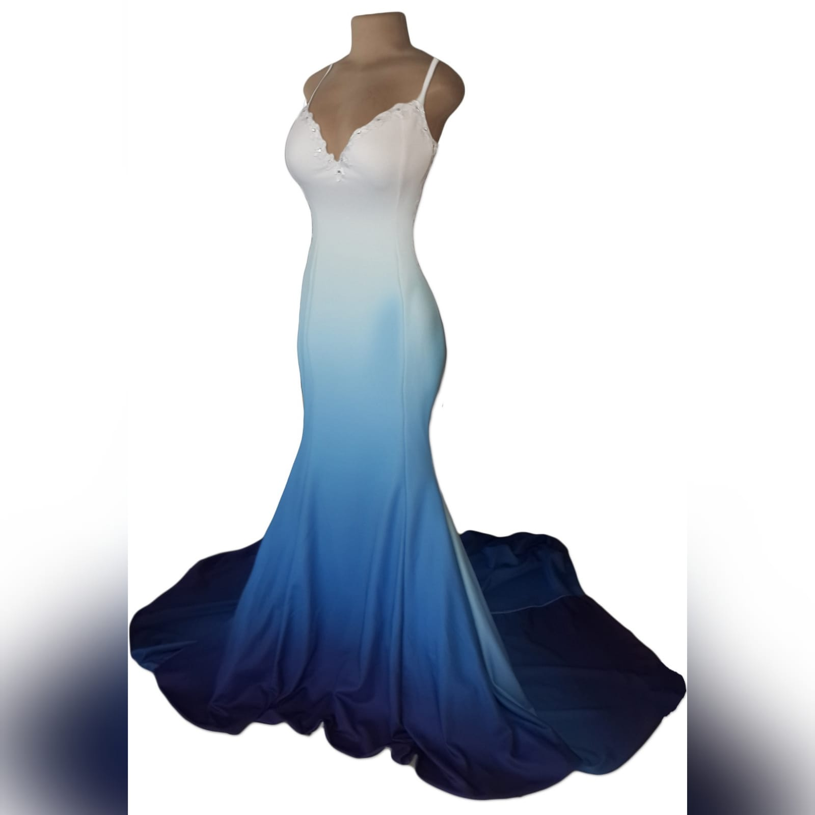 White & blue ombre soft mermaid prom dress with a sheer lace back 6 white & blue ombre soft mermaid prom dress with a sheer lace back. A sweetheart neckline. With a touch of silver beads and a train