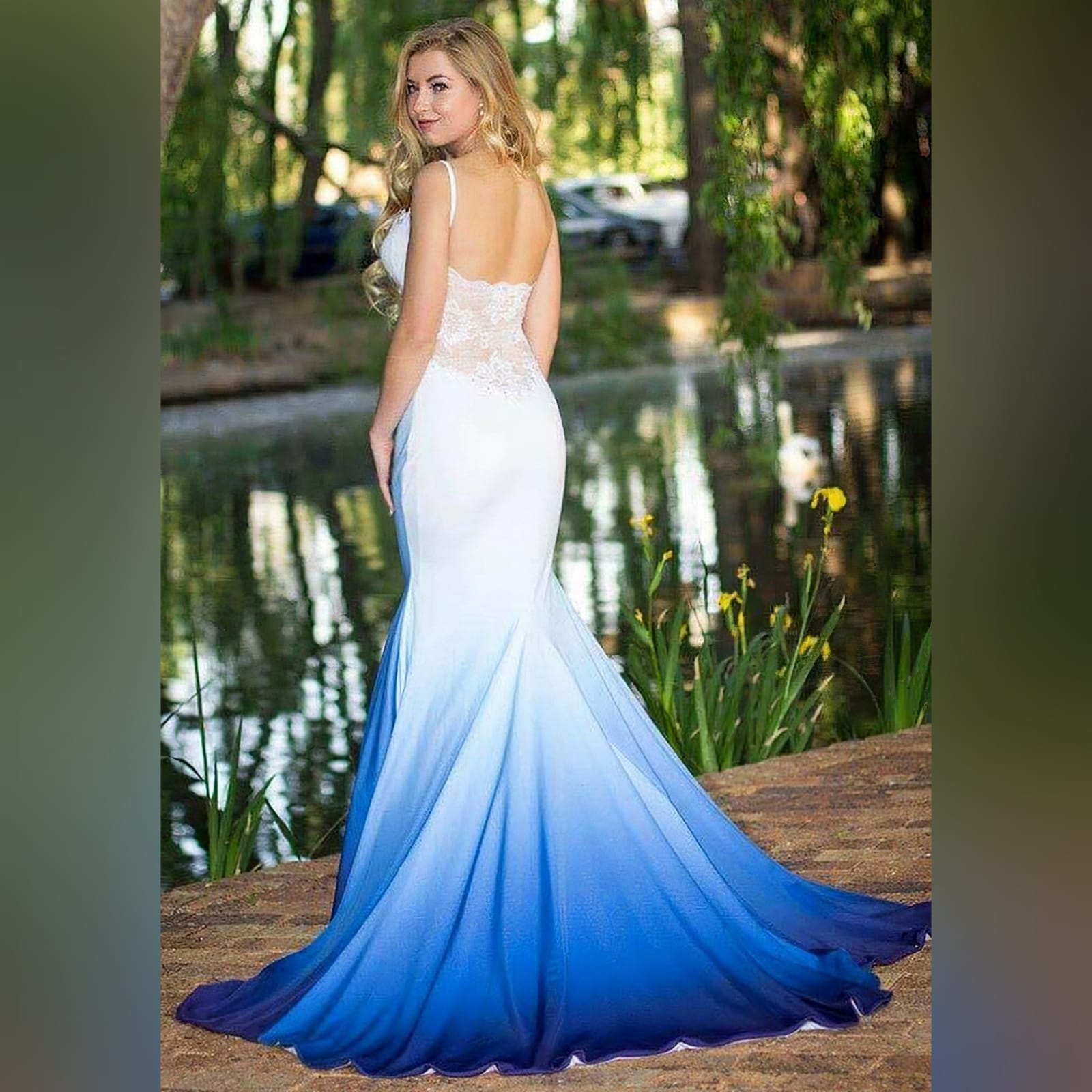 White & blue ombre soft mermaid prom dress with a sheer lace back 3 white & blue ombre soft mermaid prom dress with a sheer lace back. A sweetheart neckline. With a touch of silver beads and a train