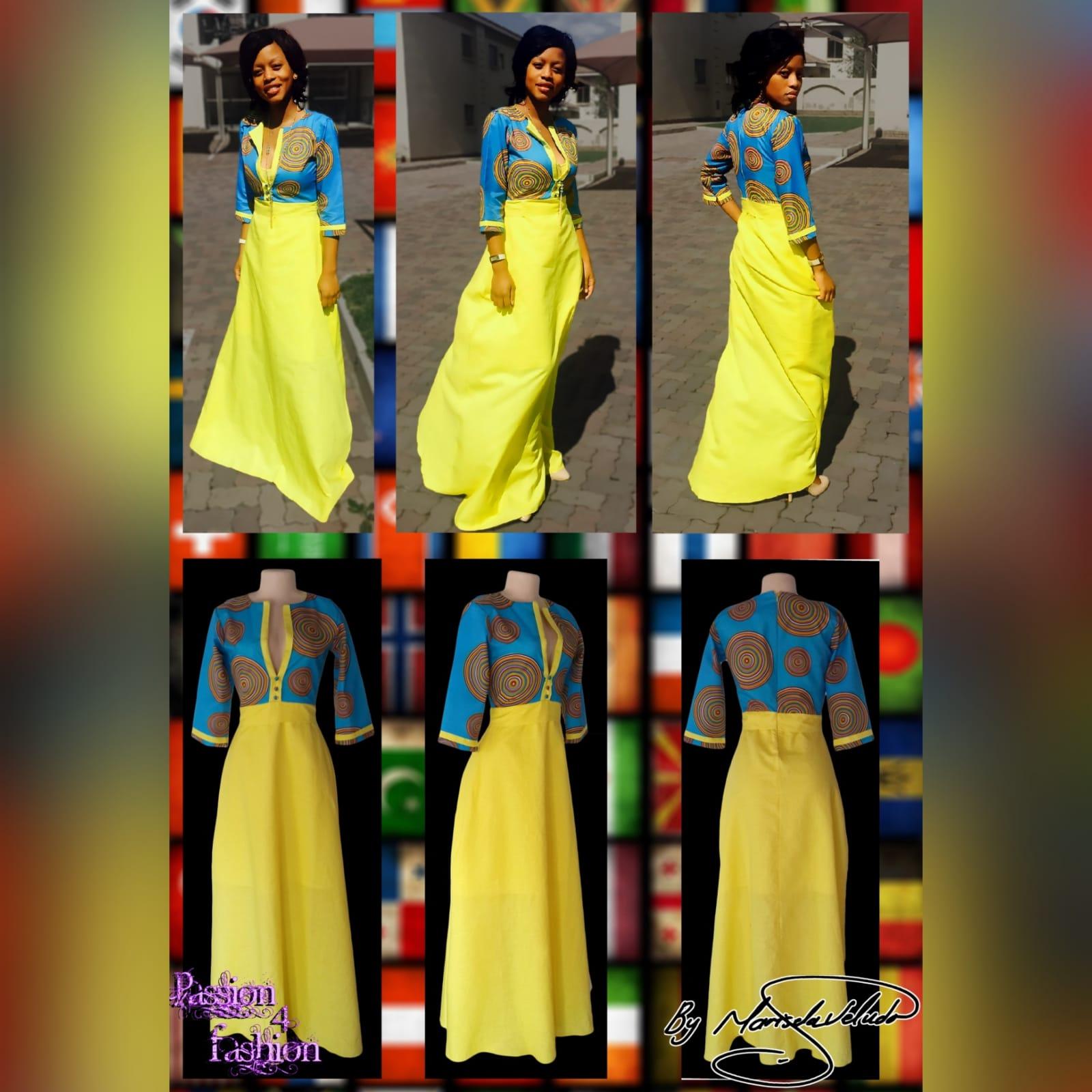 Blue & yellow modern traditional dress 2 modern traditional blue and yellow empire fit dress. Flowy bottom, neckline with a slit.