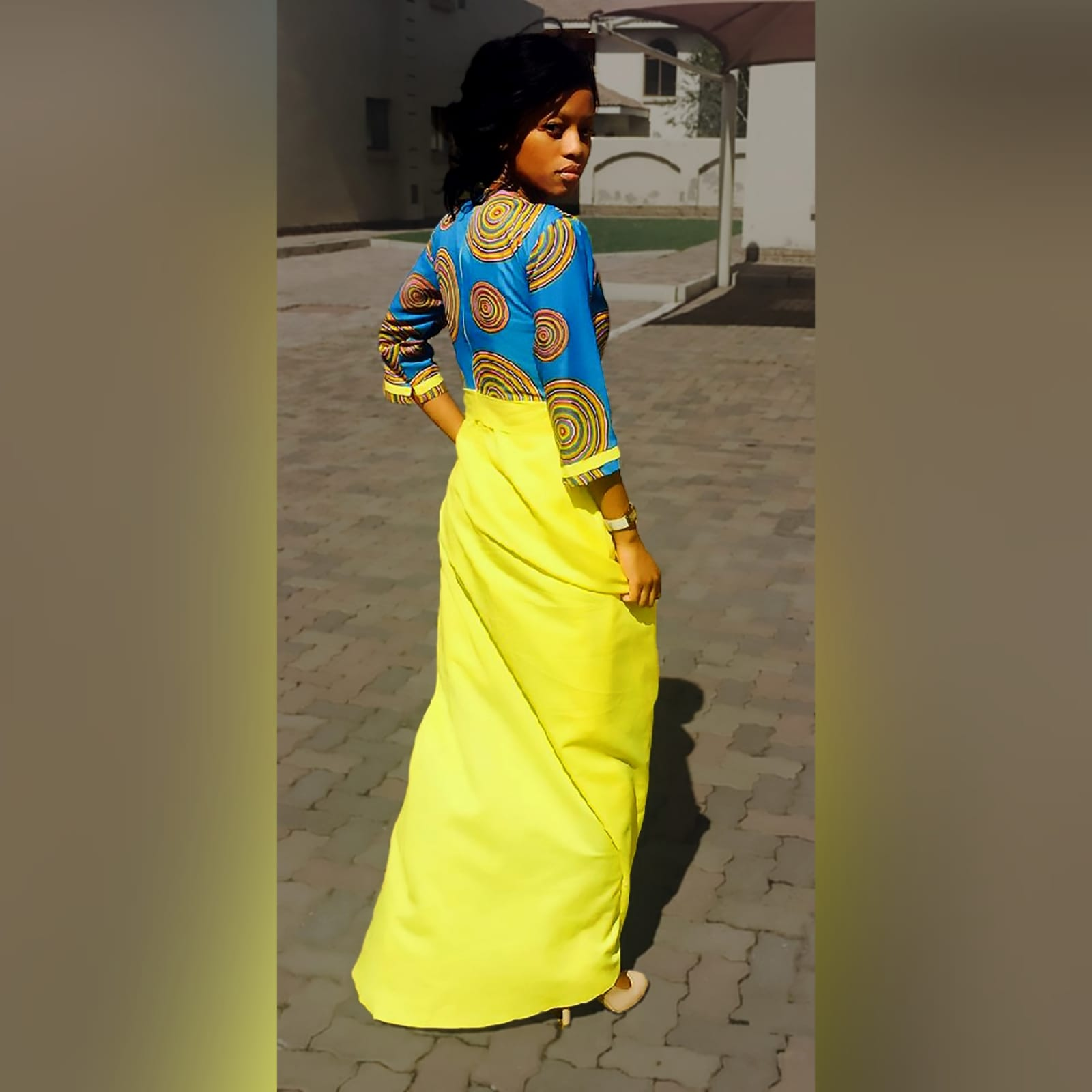 Blue & yellow modern traditional dress 3 modern traditional blue and yellow empire fit dress. Flowy bottom, neckline with a slit.